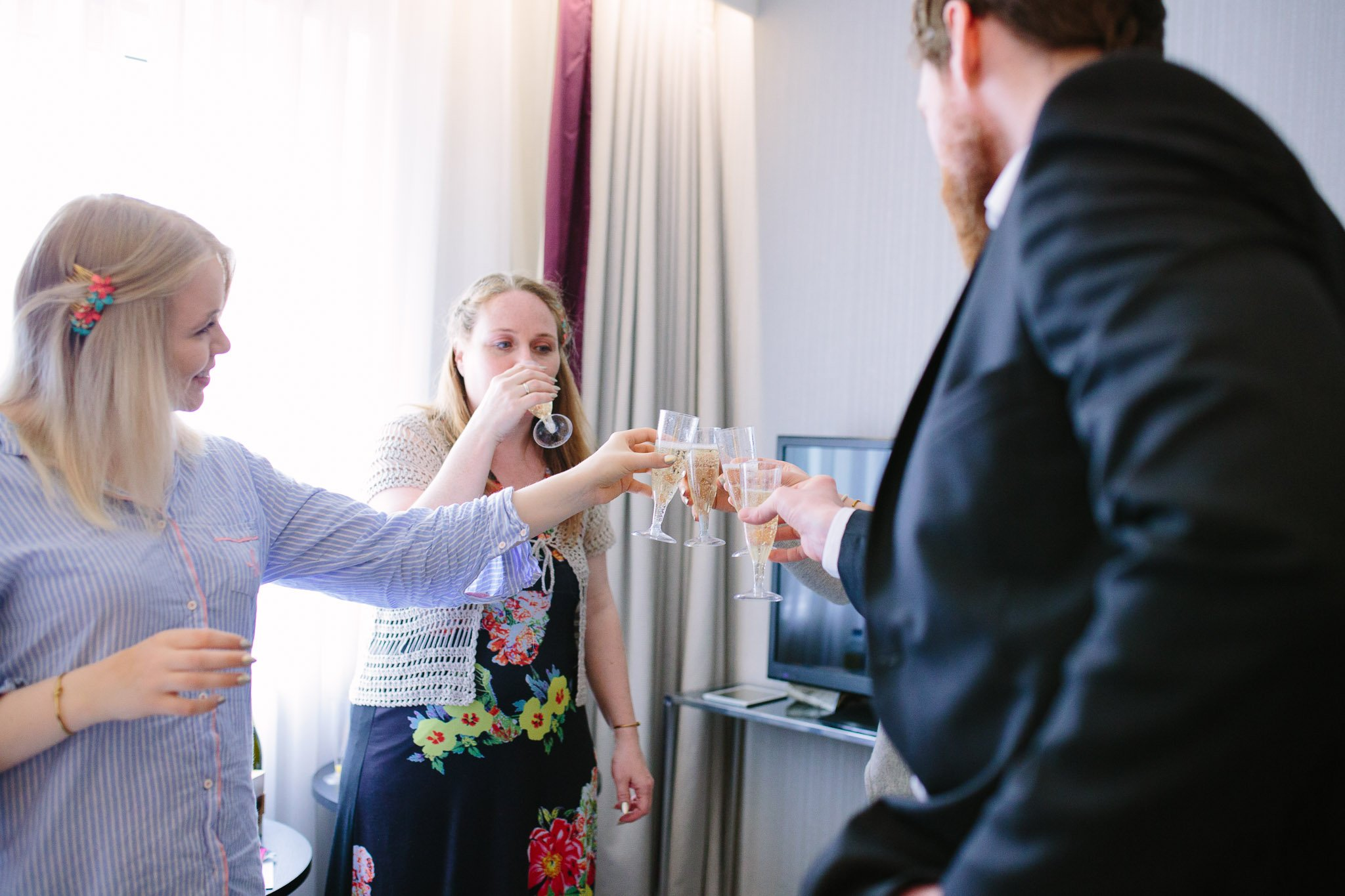 Bridesmaids & bride man champagne toast at Hilton Hotel Angel Islington