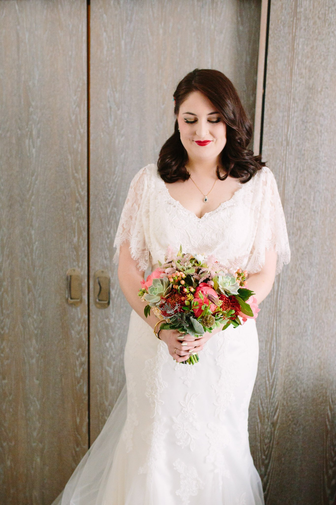 Portrait of bride in wedding dress holding bouquet at Hilton Hotel Angel Islington