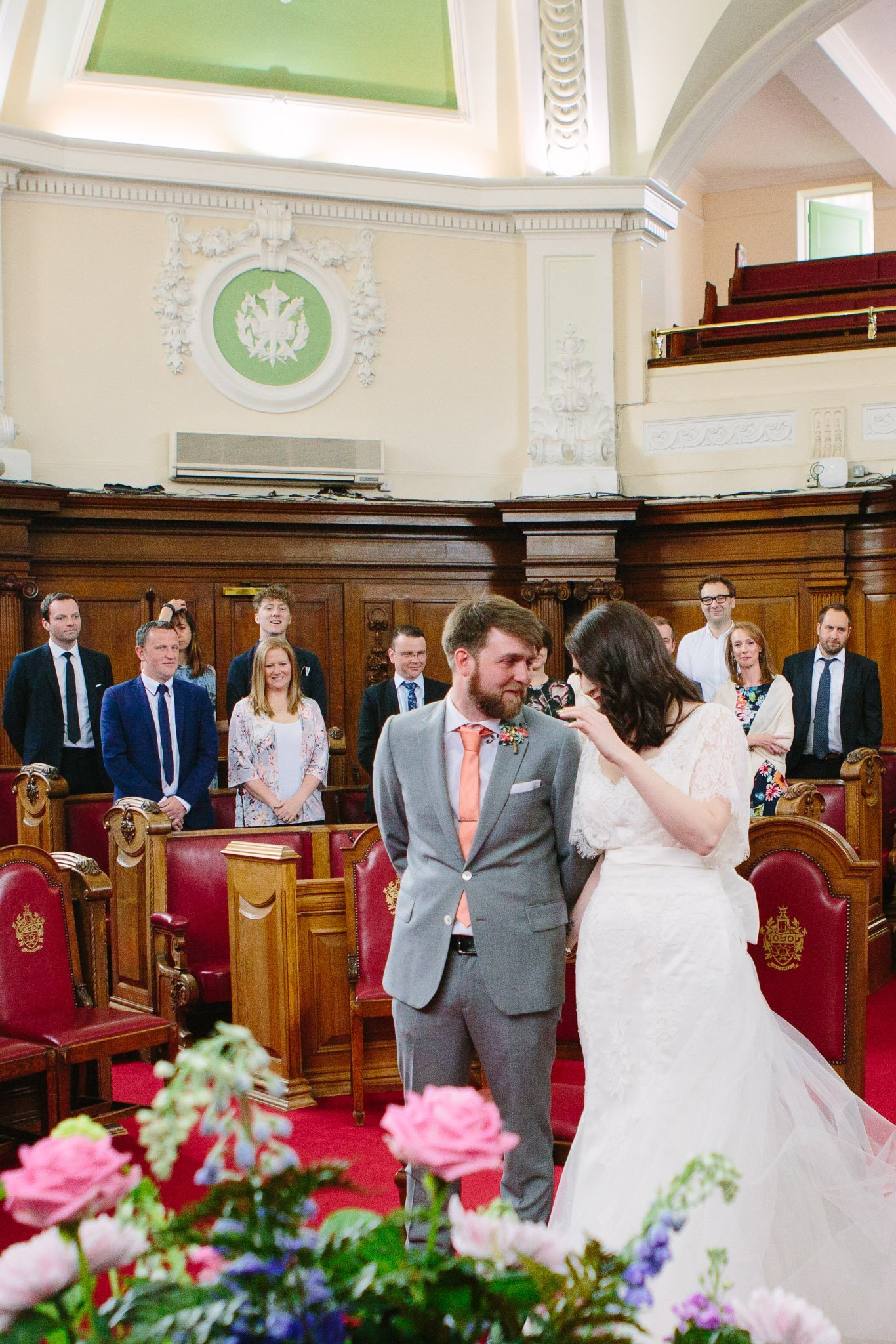 Emotional bride & groom at ceremony at Islington Town Hall