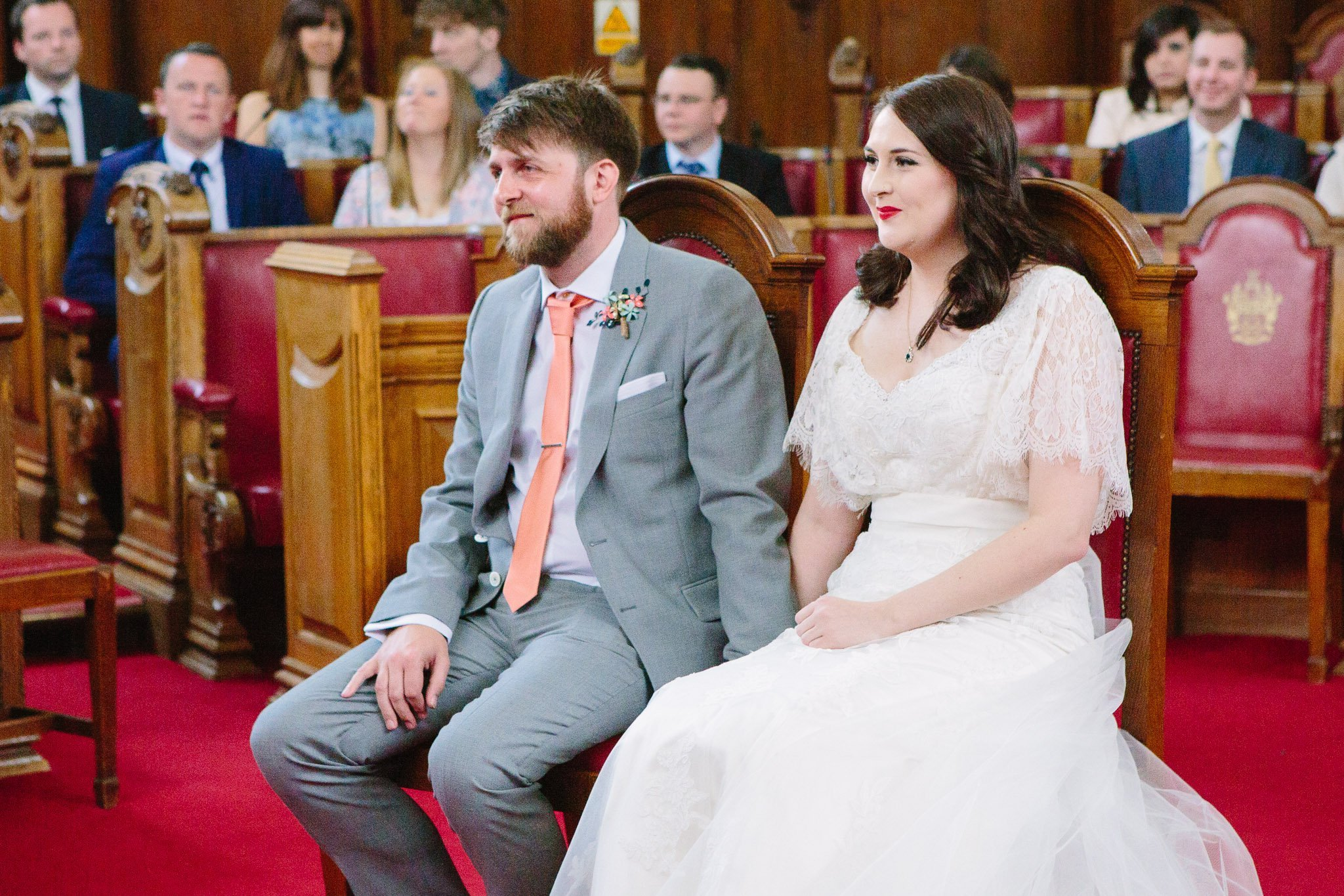 Seated bride & groom at ceremony at Islington Town Hall