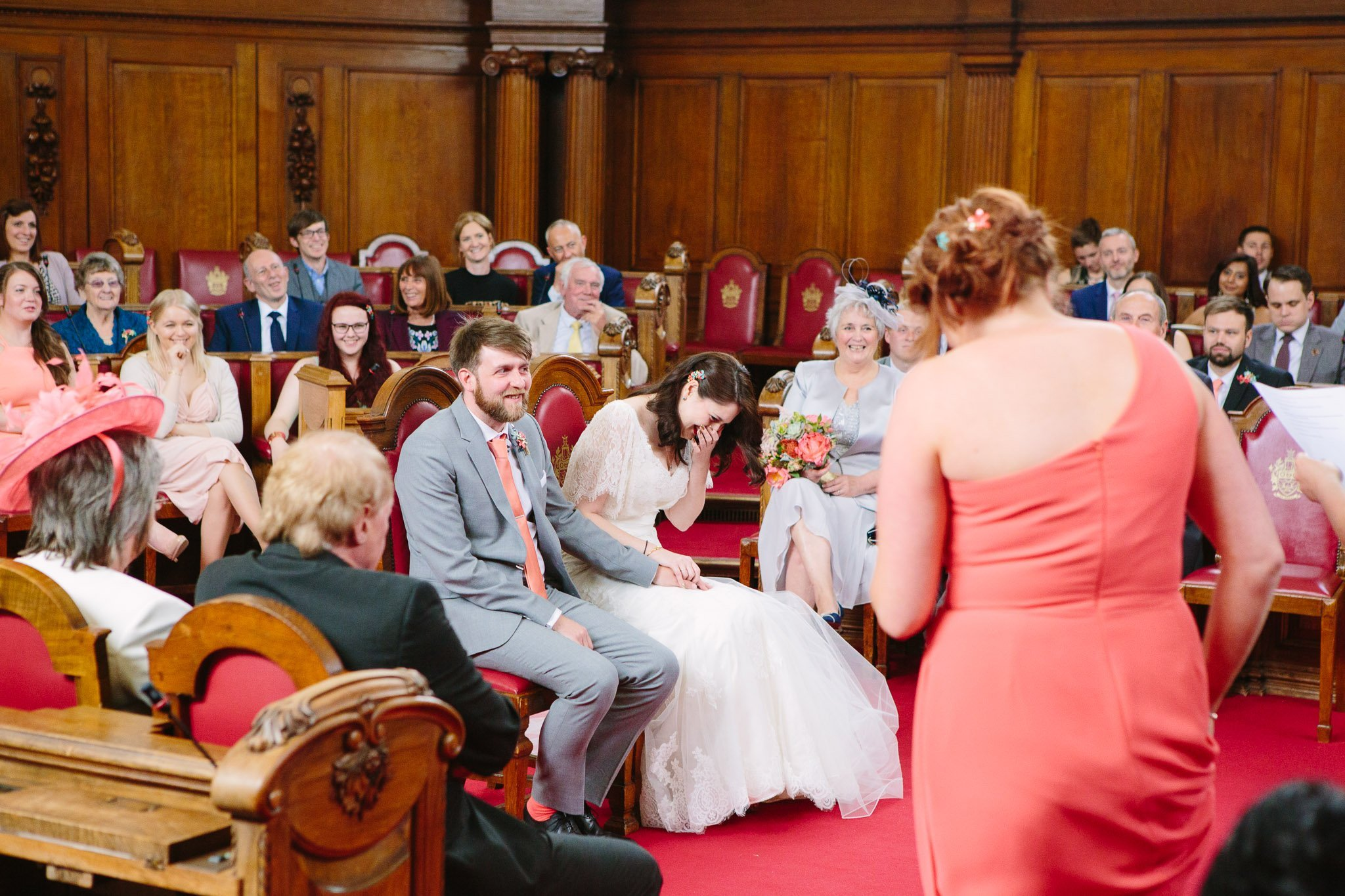Bride laughing at speech of bridesmaid at Islington Town Hall