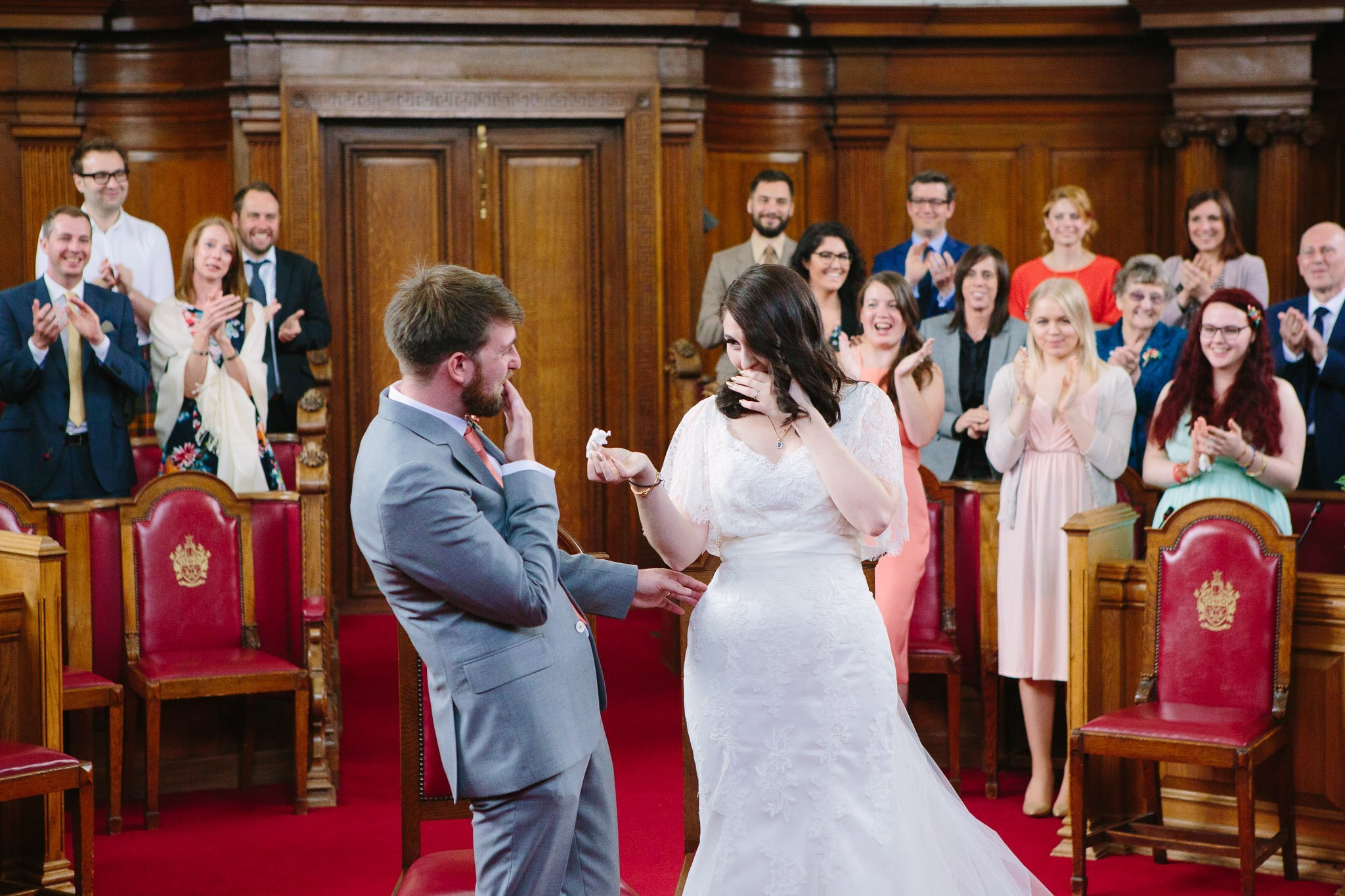 Laughing bride & groom at Islington Town Hall Wedding