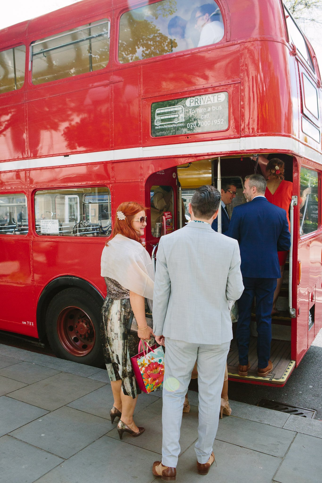 Guests getting on Routemaster bus at Islington Town Hall Wedding