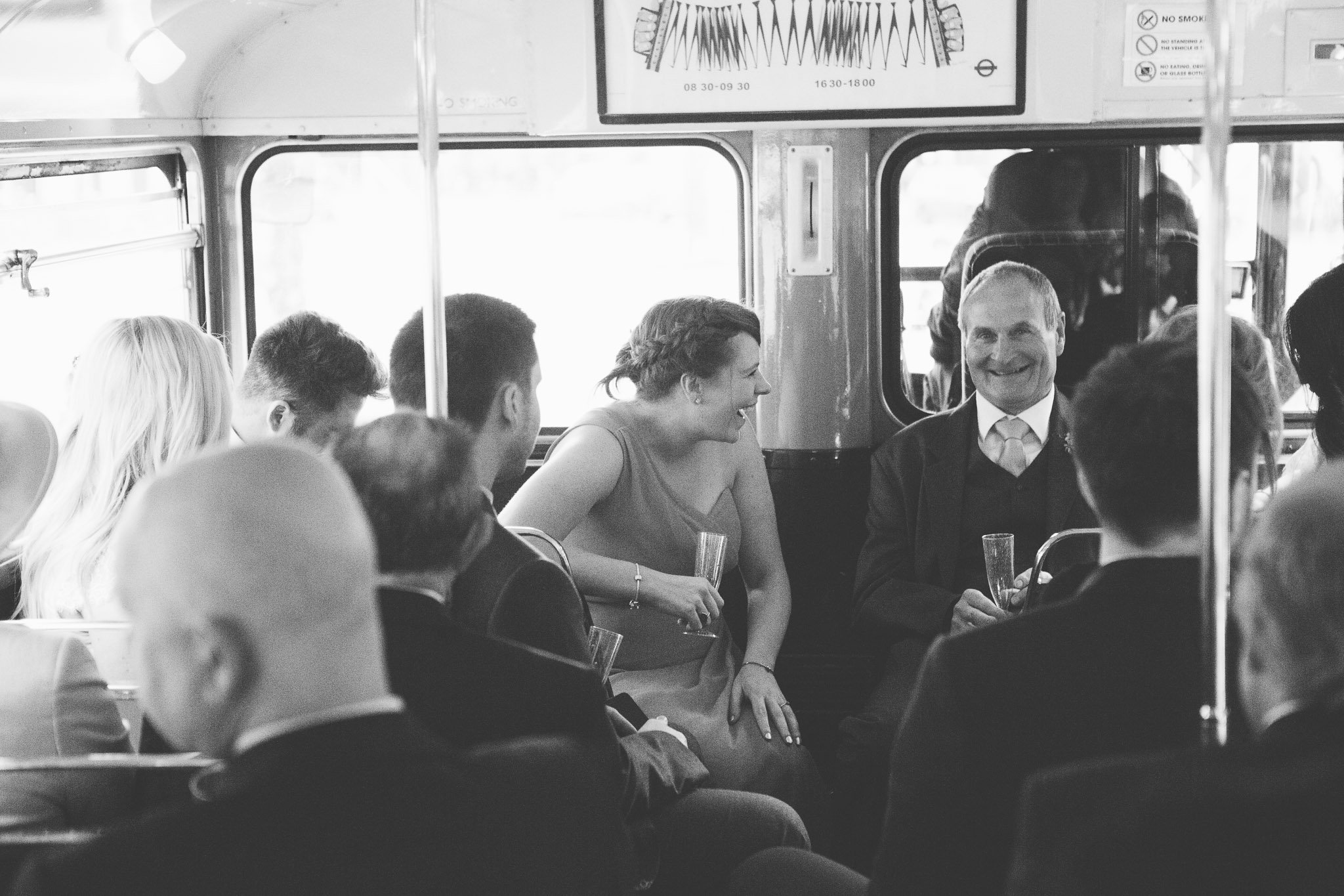 Wedding guests on bus at Islington Town Hall Wedding
