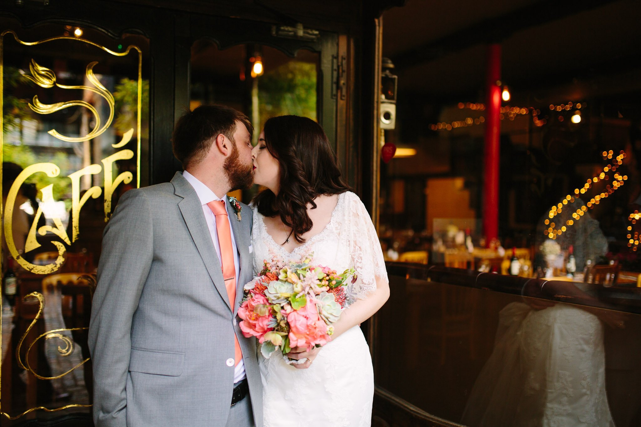 Portrait of couple kissing at The Depot Carpenter's mews