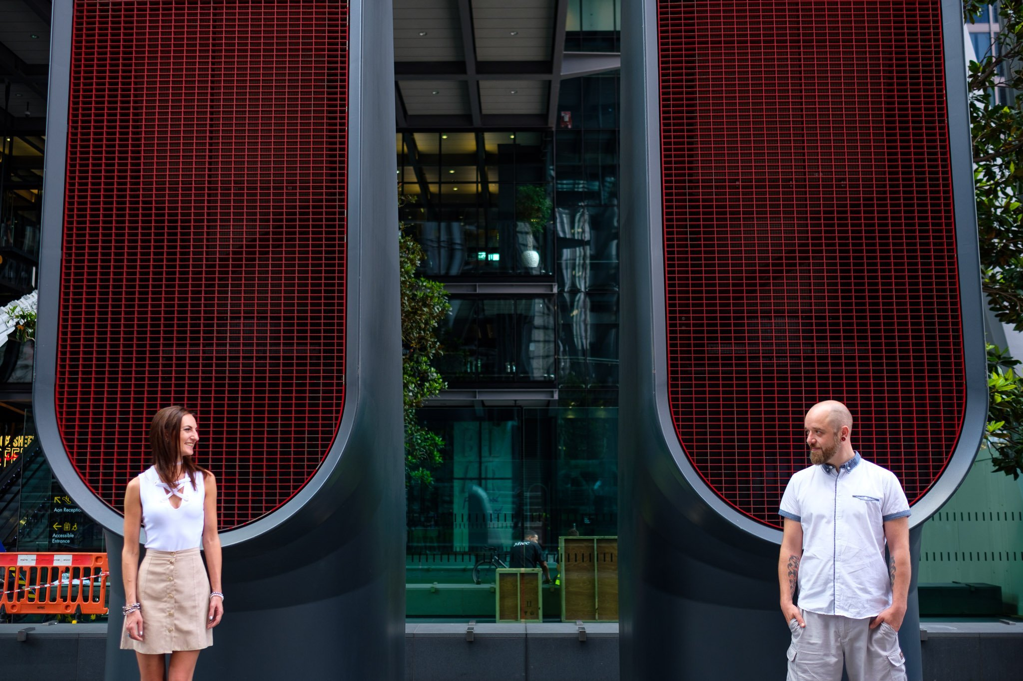 Engagement portrait of couple with abstract background London