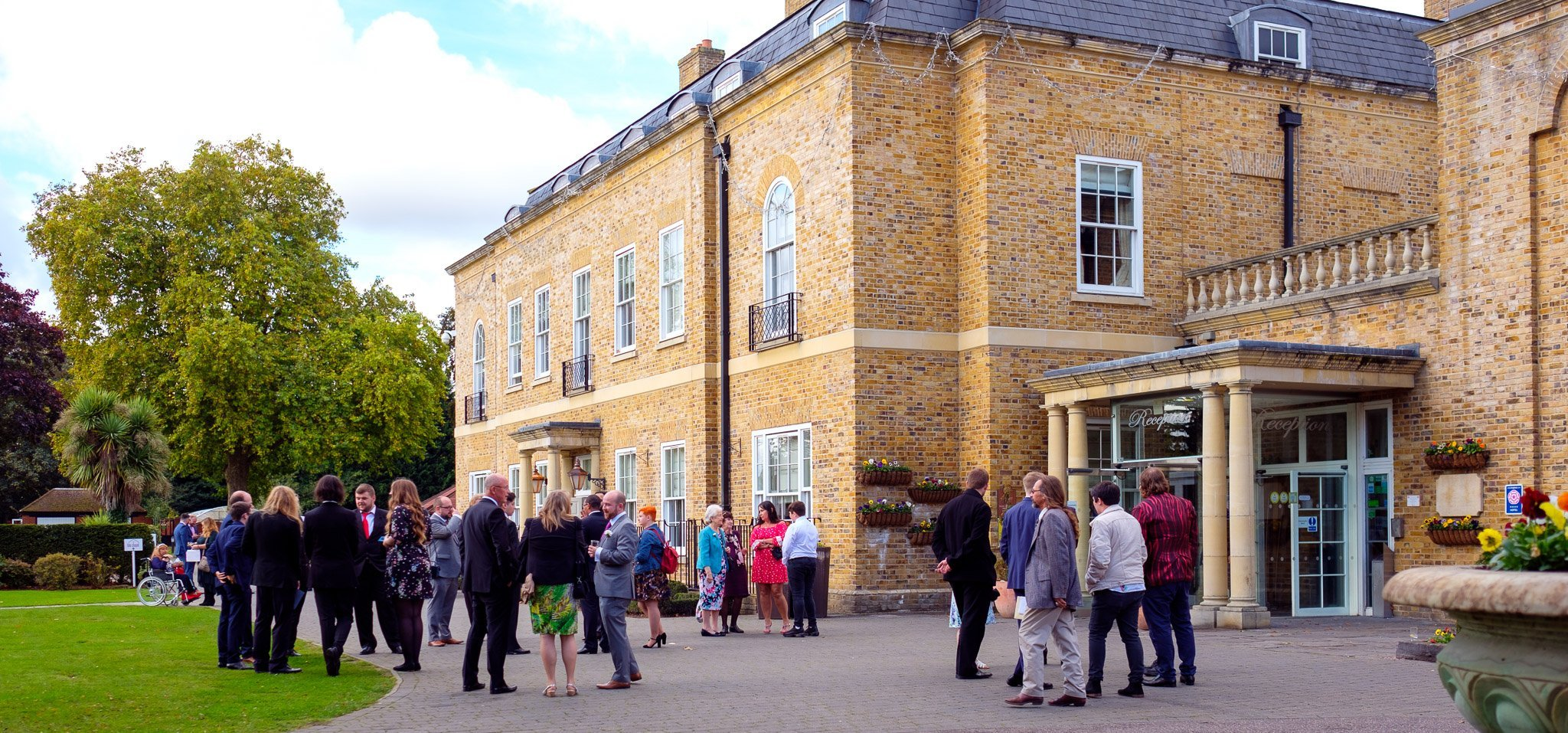 Guests waiting outside Orsett Hall Hotel Essex Wedding