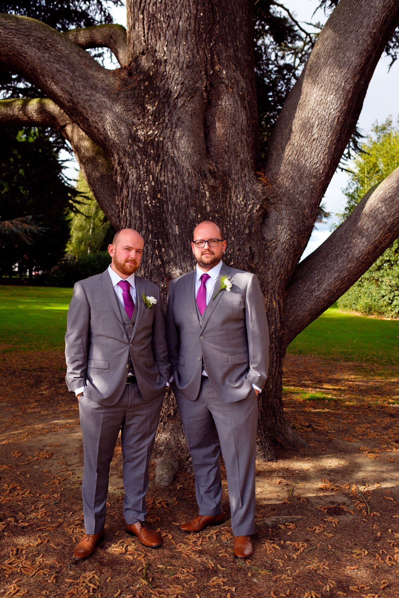 Groom and brother standing by a tree at Orsett Hall Hotel Essex Wedding