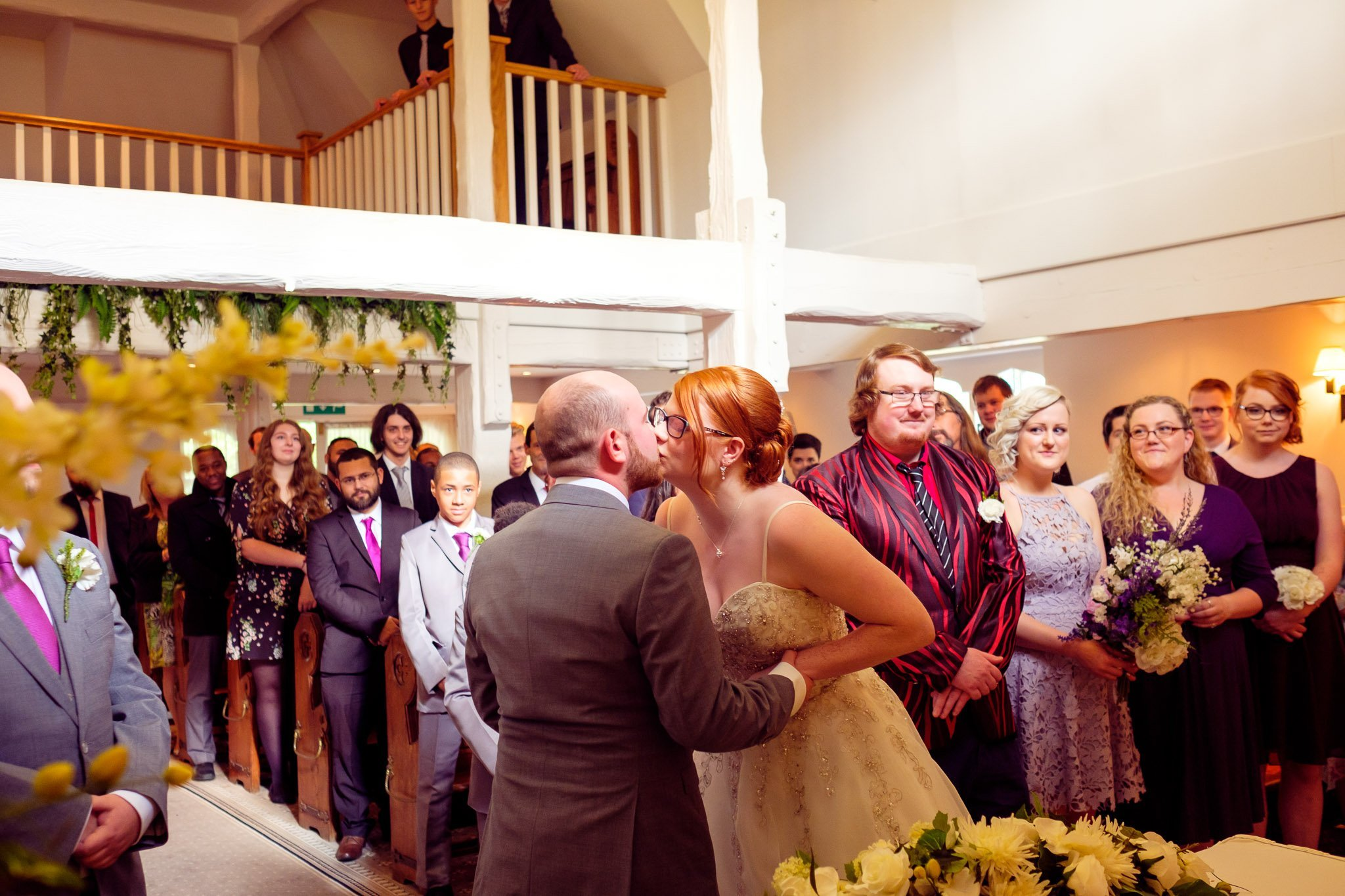 First kiss of bride & groom as a married couple at The Chapel at Orsett Hall Hotel Essex Wedding