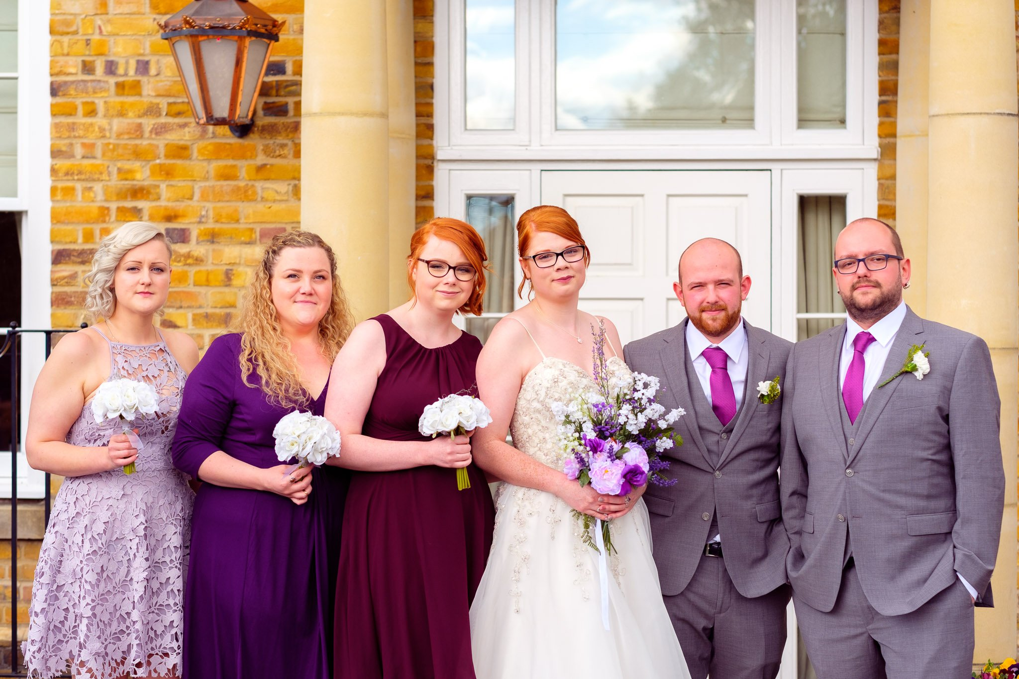 Bridal party group shot outside Orsett Hall Hotel Essex Wedding