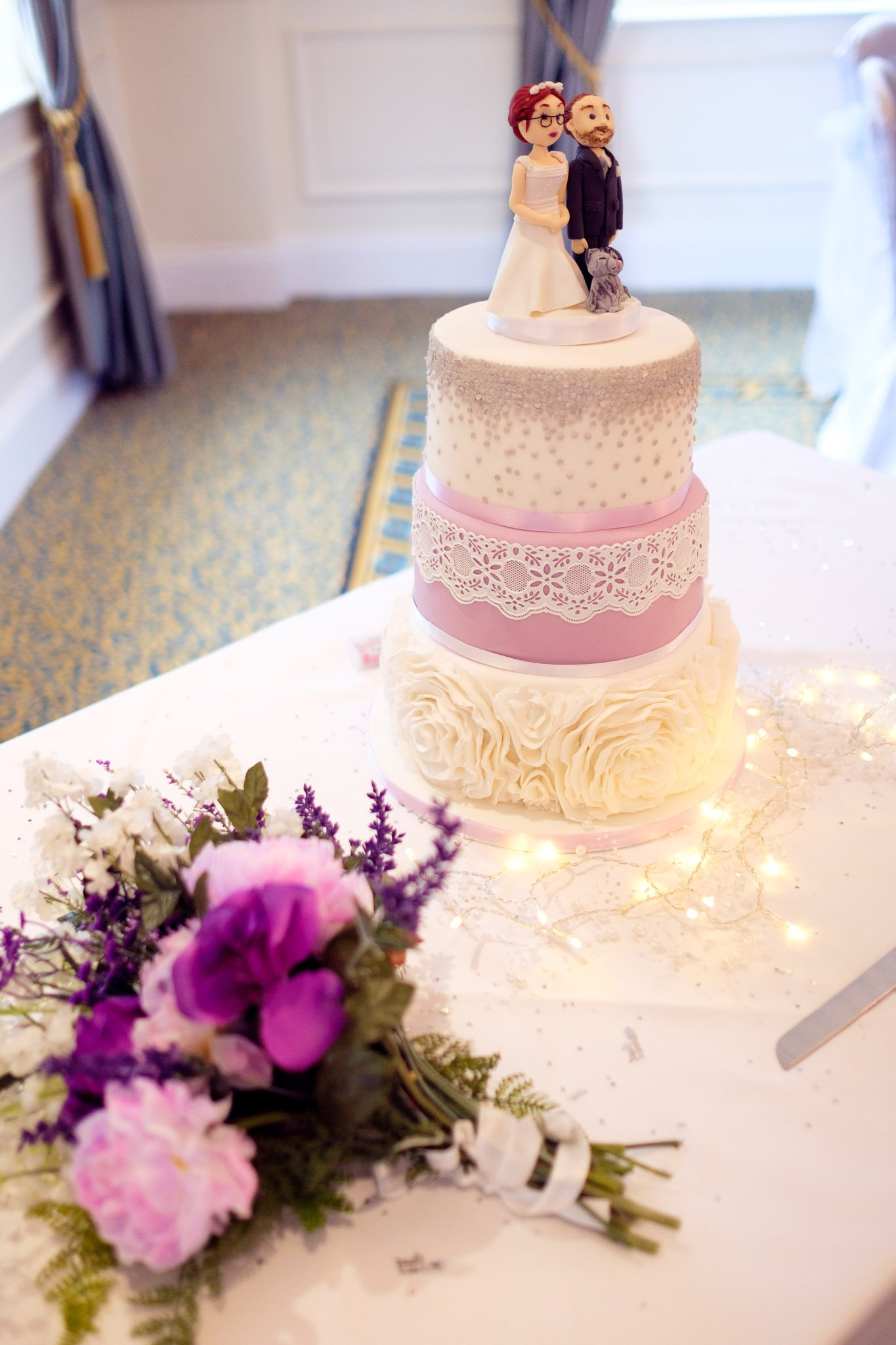 Iced 3 tier wedding cake with personalised bride & groom cake topper at Orsett Hall Hotel Essex