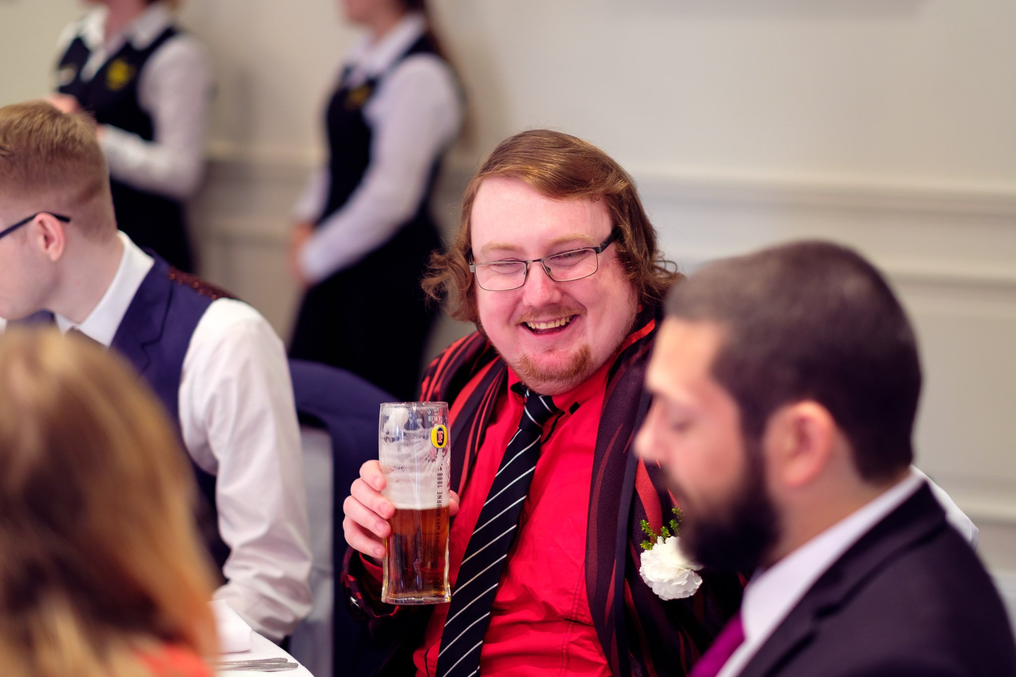 Laughing guest at wedding reception at Orsett Hall Hotel Essex