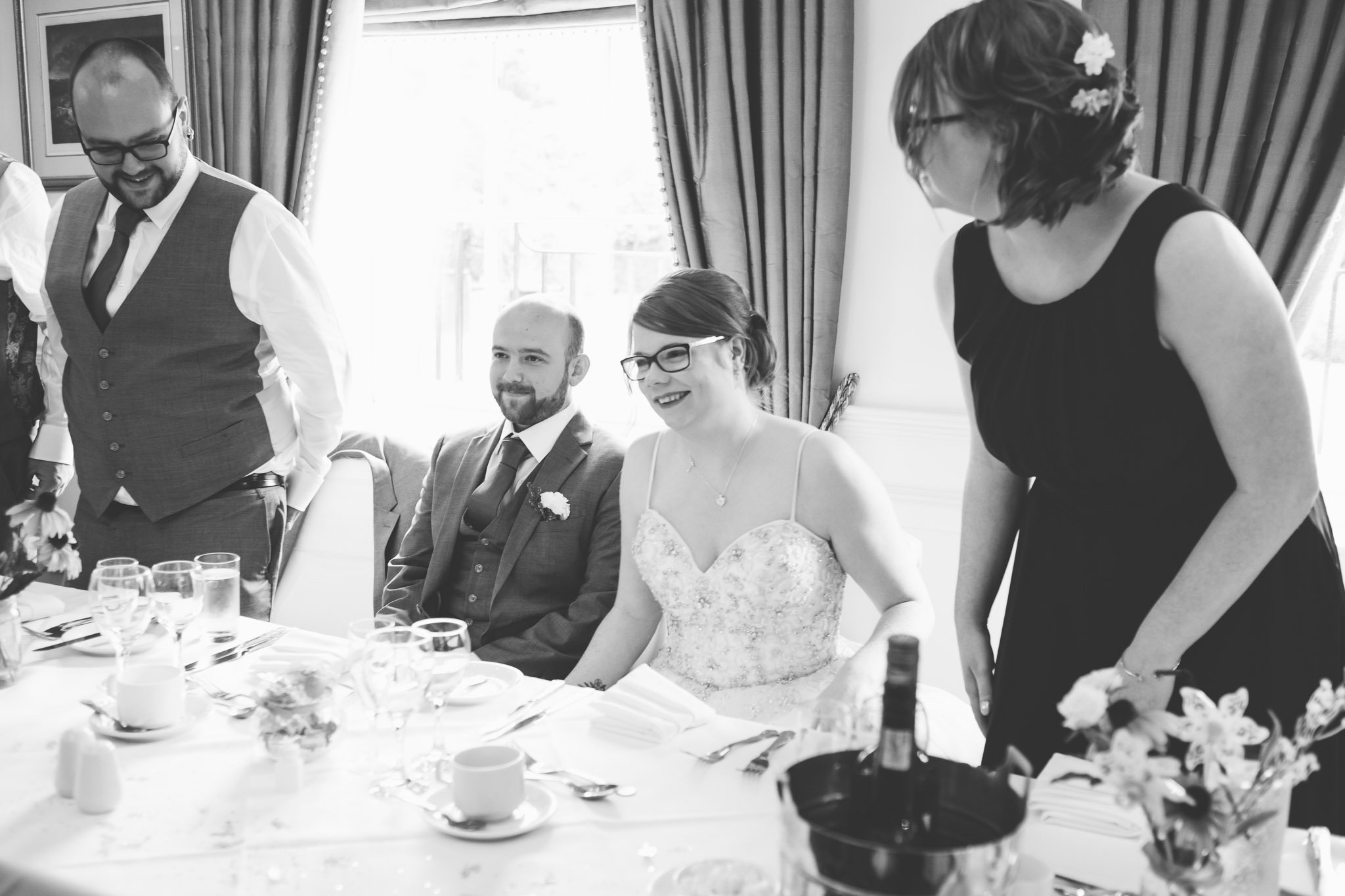 Bride & groom at the head table at wedding reception at Orsett Hall Hotel Essex