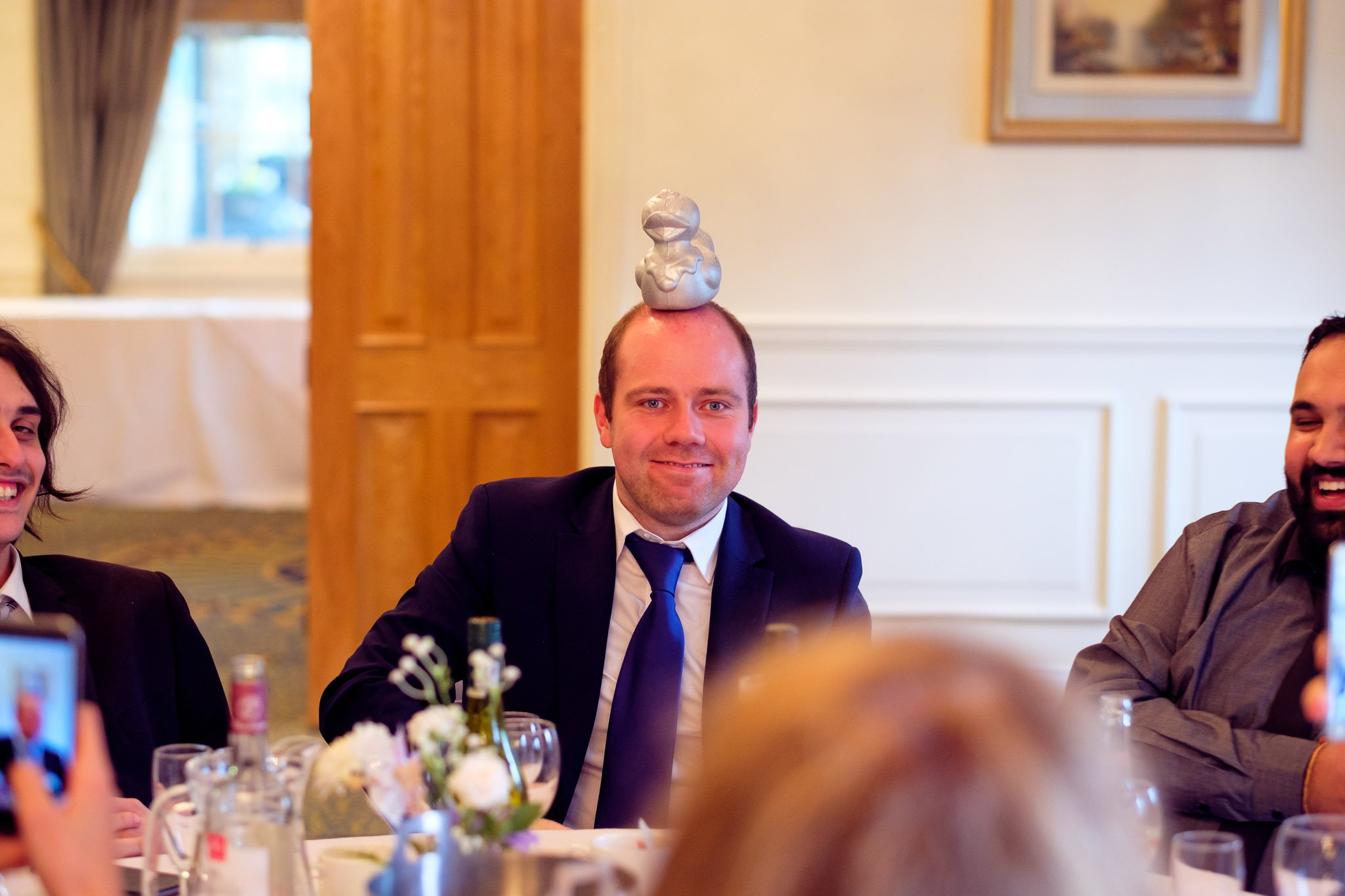 Guest with object on head at Wedding reception at Orsett Hall Hotel Essex