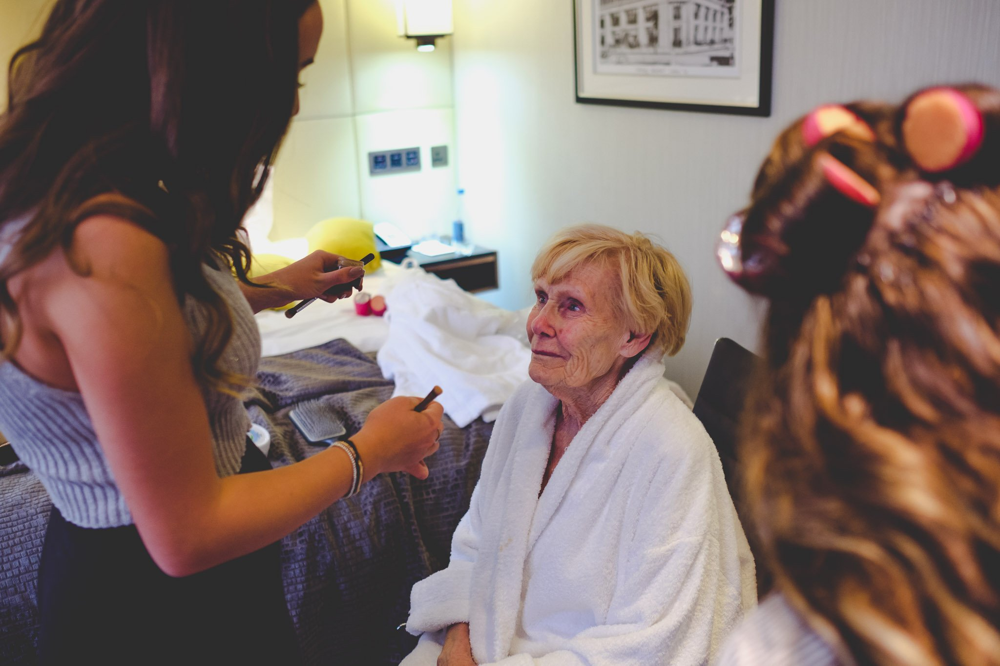 Close up of an emotional grandma getting ready before the wedding. Photography by thatthingyoupluck.