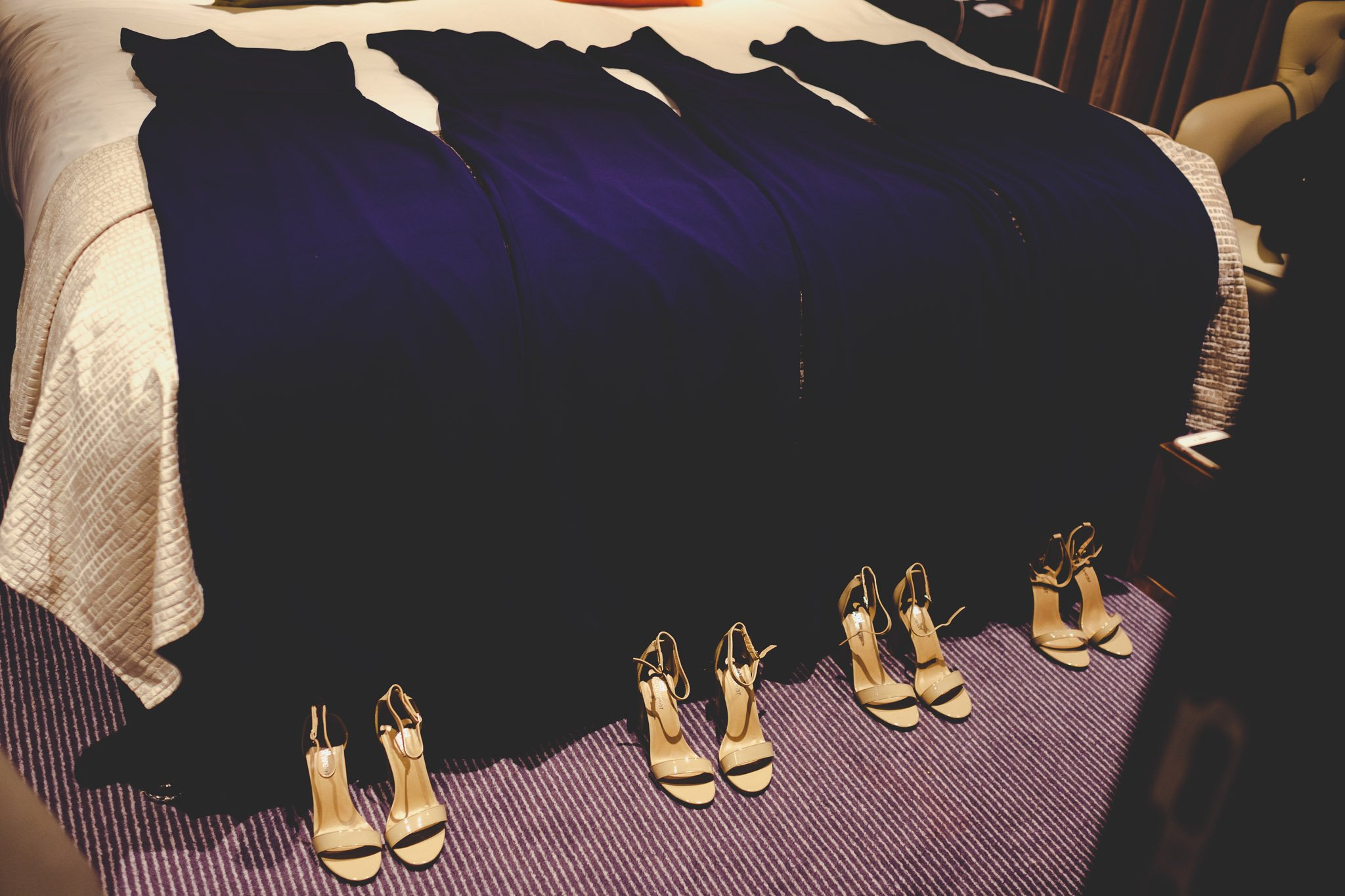 Bridesmaids navy blue dresses and heels at The Montcalm Hotel Finsbury Square London