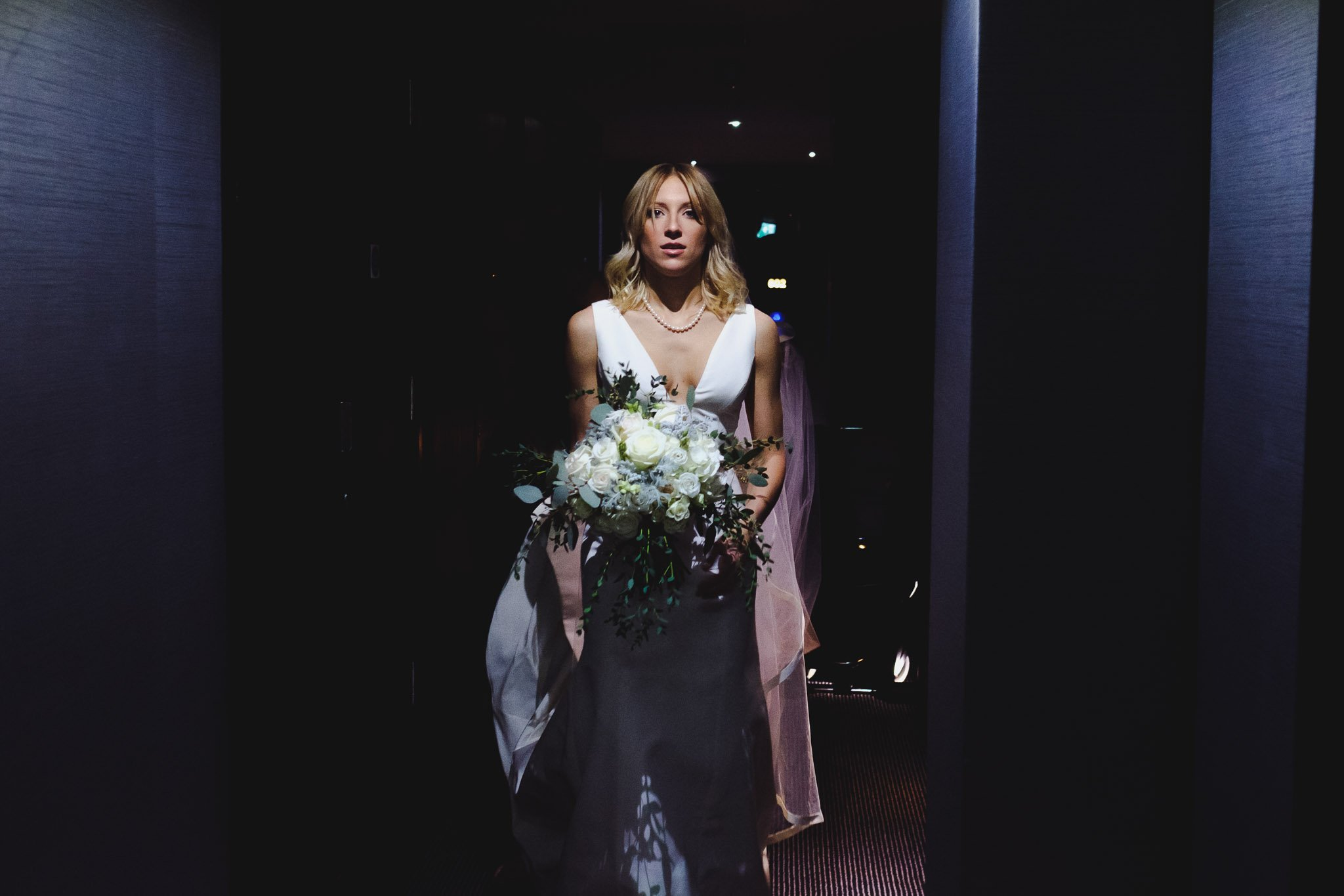 Bride walking with bouquet at The Montcalm Hotel Finsbury Square London