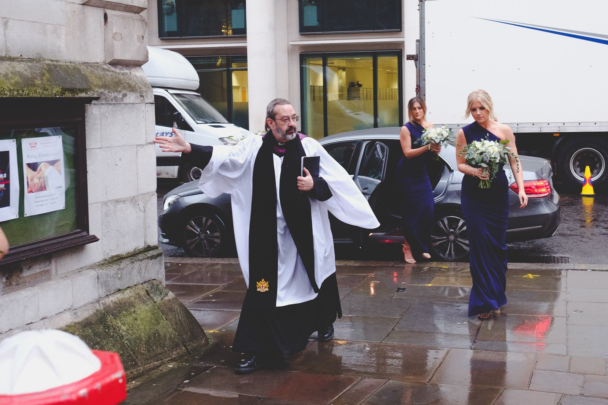 Priest & Bridesmaids entering church at St Lawrence Jewry wedding Guildhall