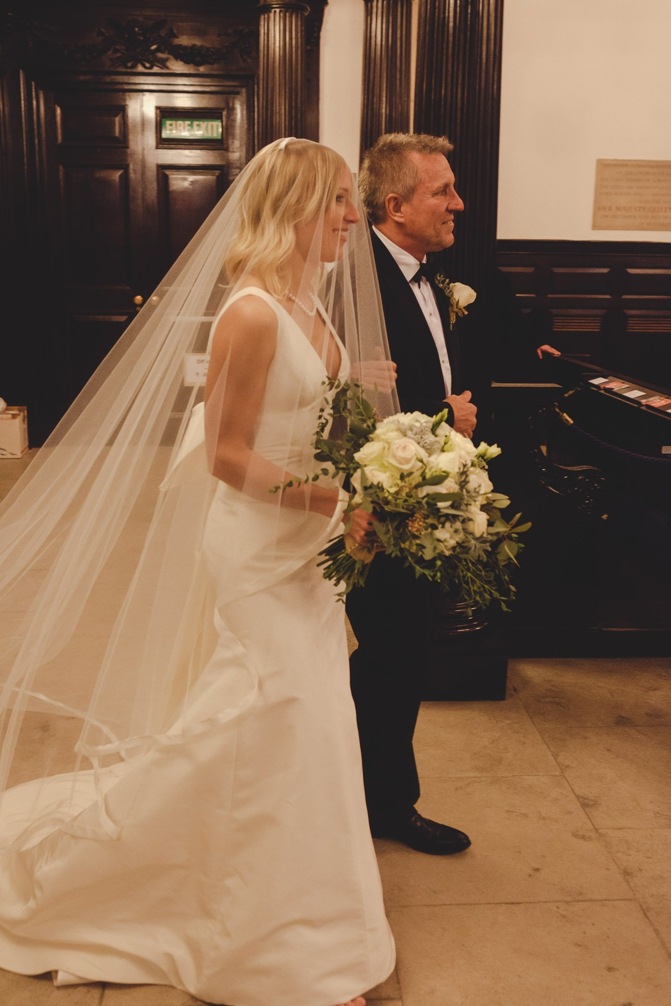 Father walking bride down the aisle at St Lawrence Jewry wedding Guildhall