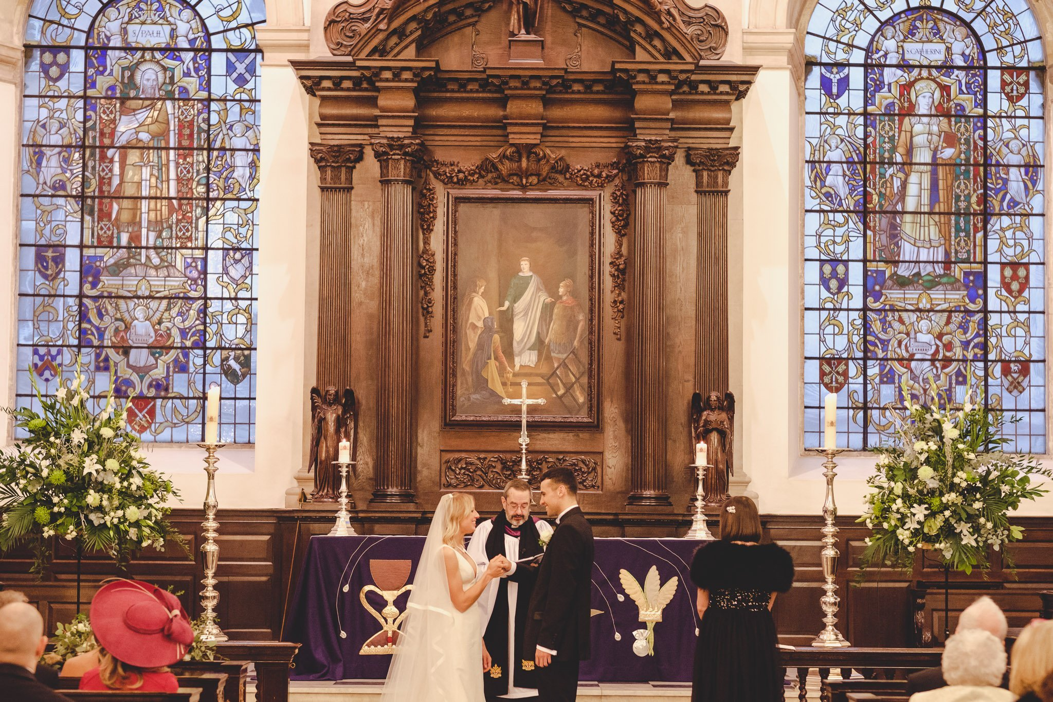 Bride & Groom holding hands at St Lawrence Jewry wedding Guildhall