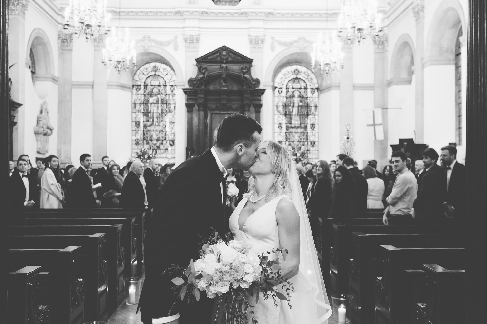 Bride & Groom First kiss at St Lawrence Jewry wedding Guildhall