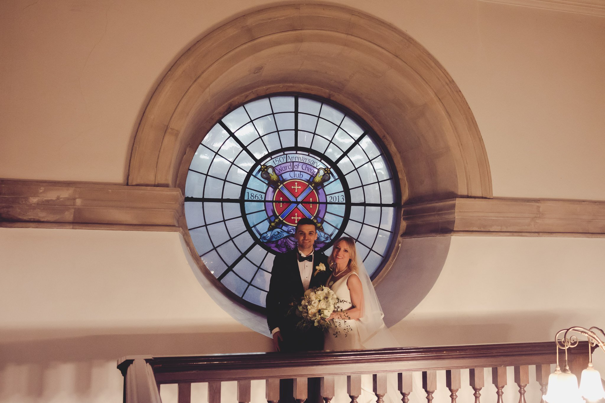 Bride & Groom portrait by a Stained Glass Window St Lawrence Jewry wedding