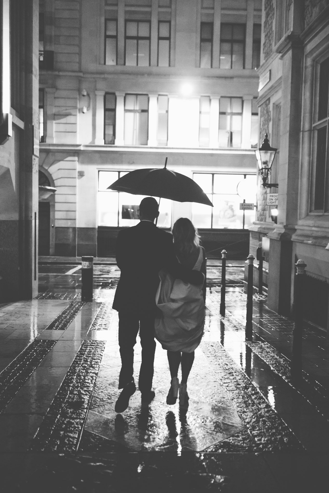 Bride & Groom walking in the rain Guildhall wedding