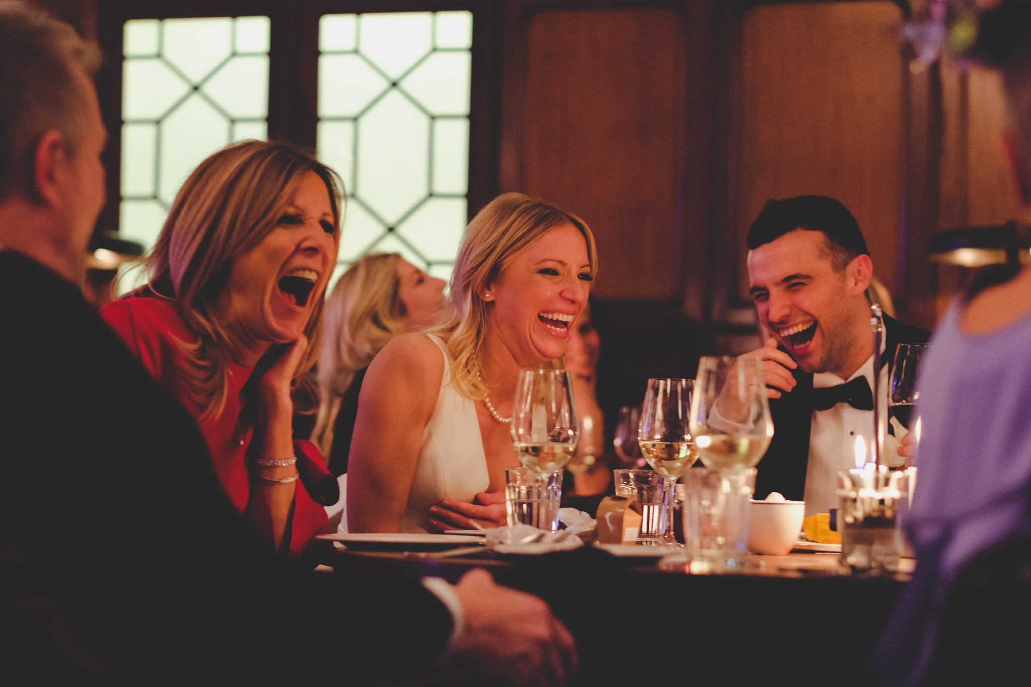 Laughing Bride & Groom at Hawksmoor Steakhouse in Guildhall London