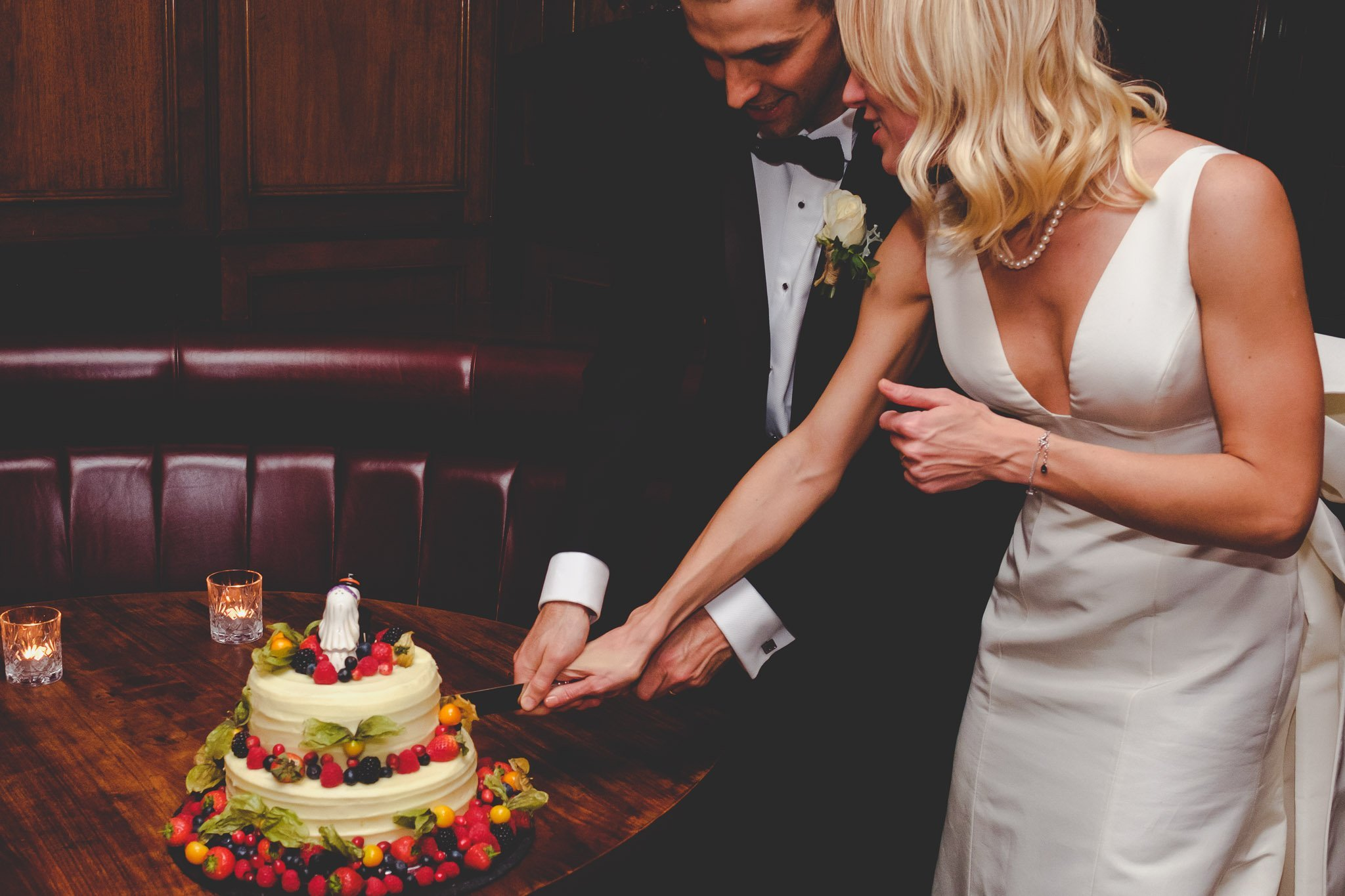 Bride & Groom cutting a cake at Hawksmoor Steakhouse in Guildhall London