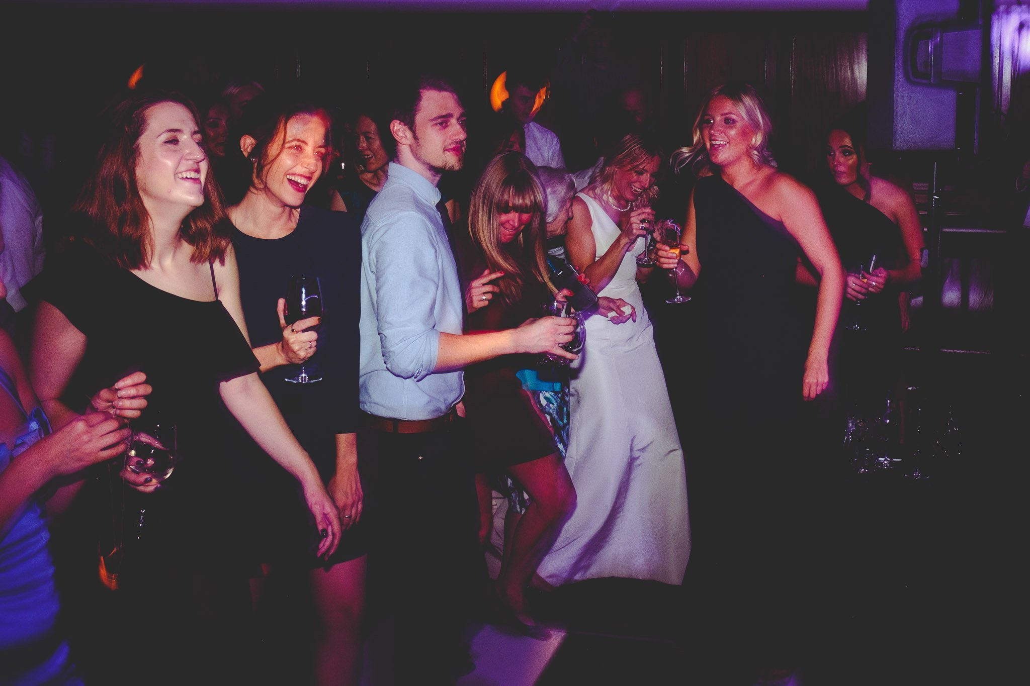 Dancing wedding guests at Hawksmoor Steakhouse in Guildhall London