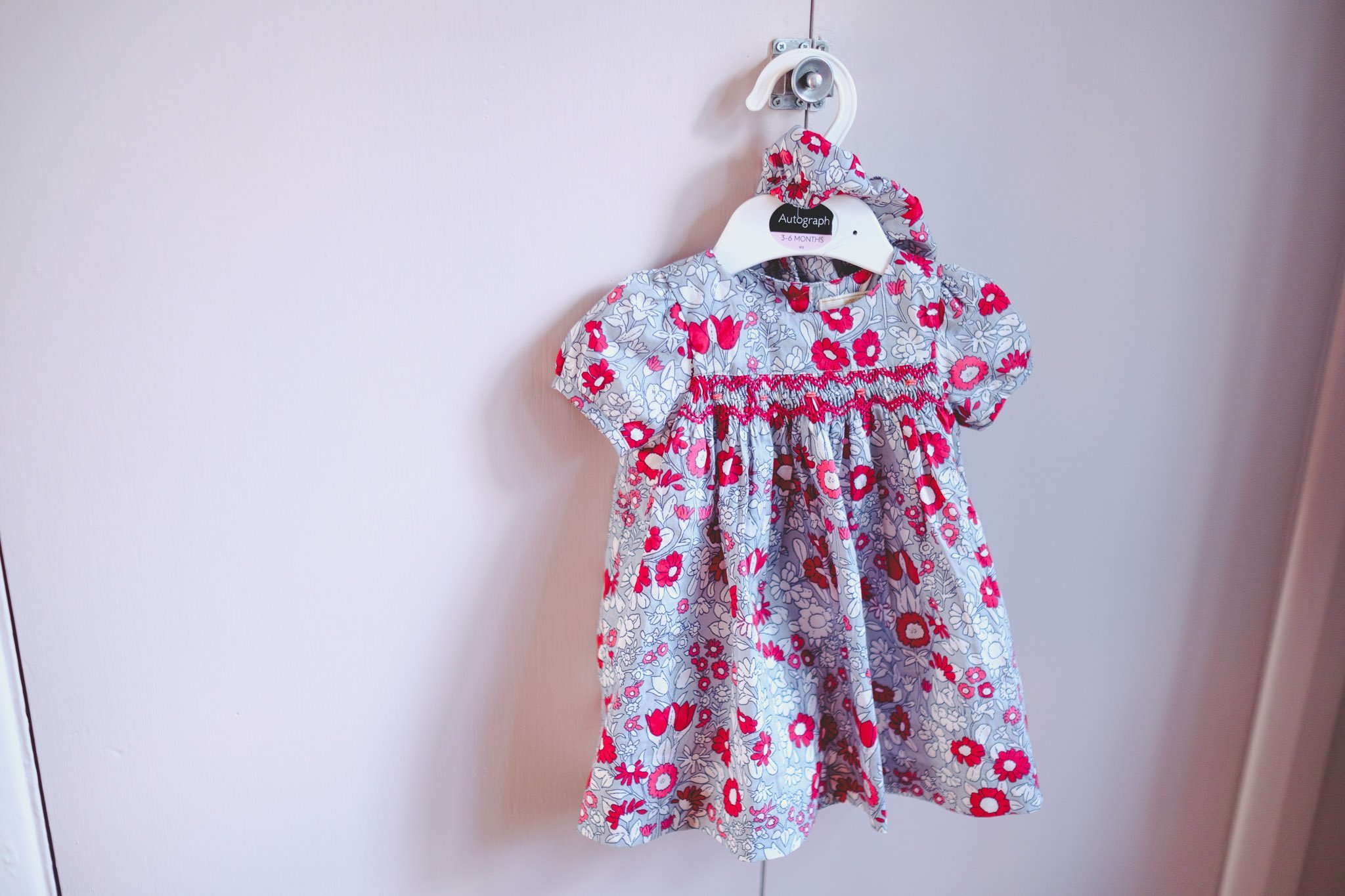 Baby dress on a hanger Lifestyle photography Chiswick