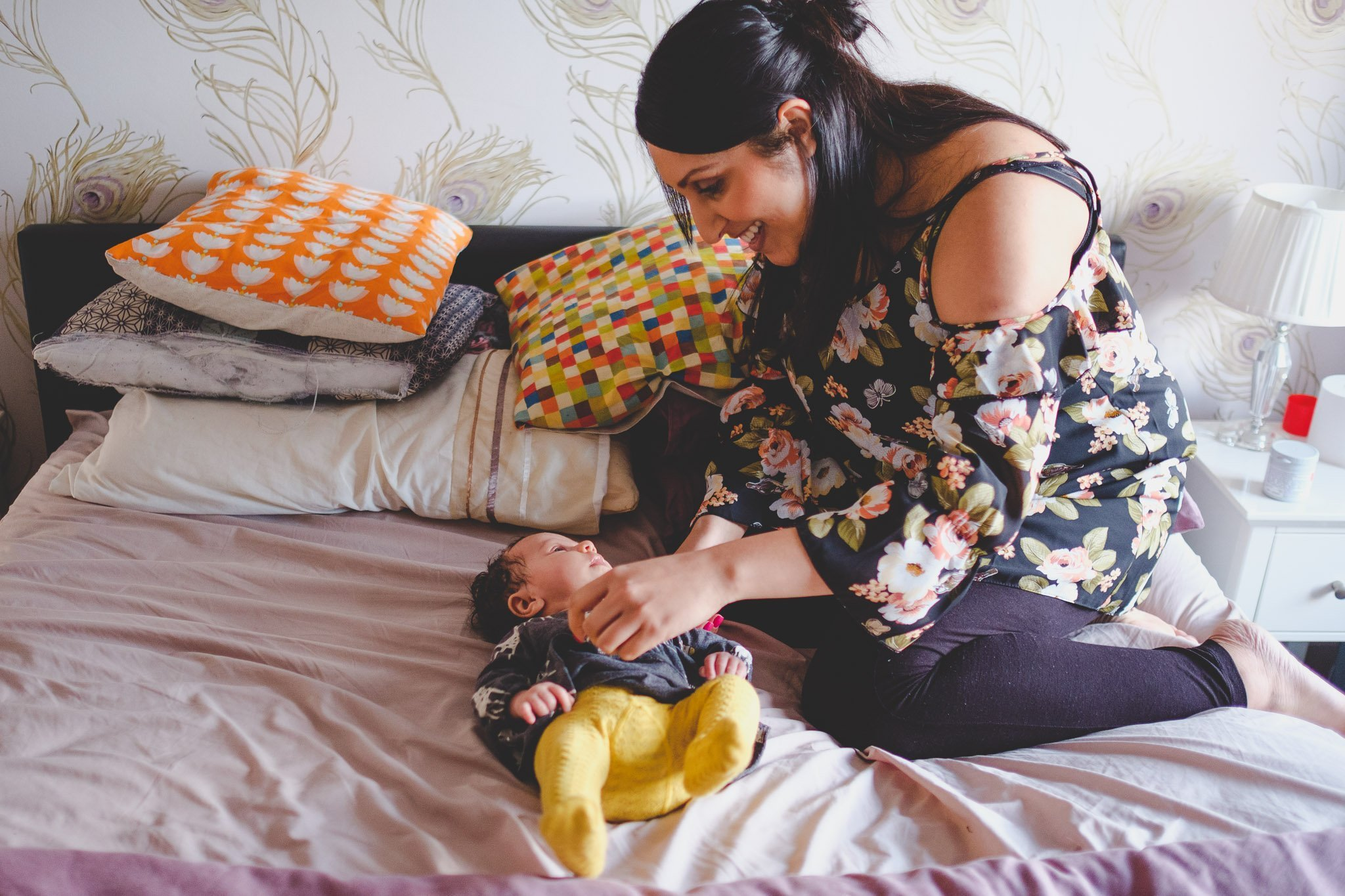 Mum & baby on bed Lifestyle photography Chiswick