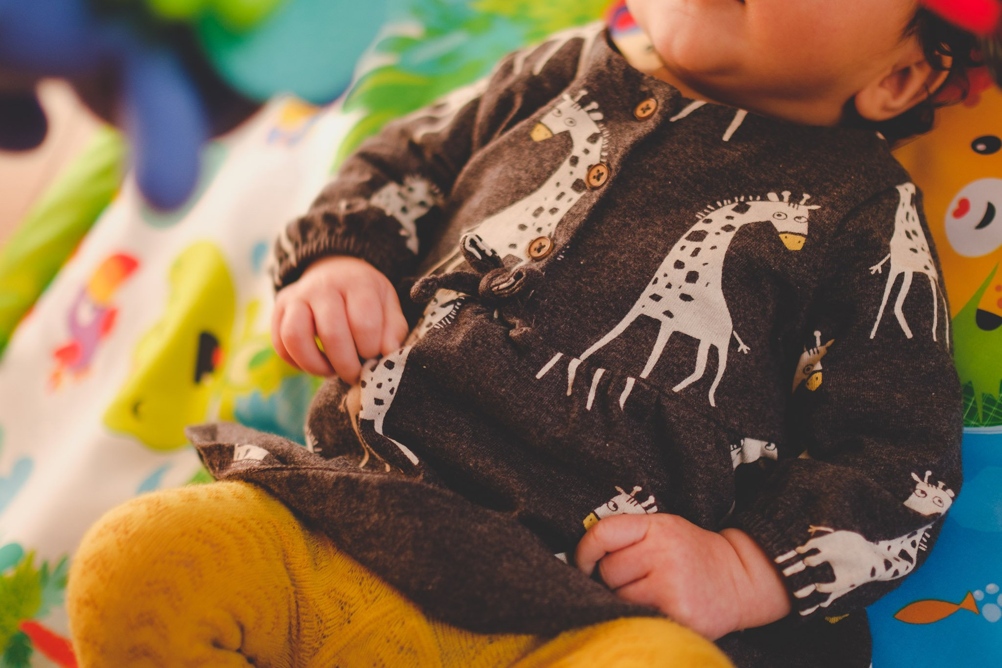 Giraffes on baby's dress Lifestyle photography Chiswick