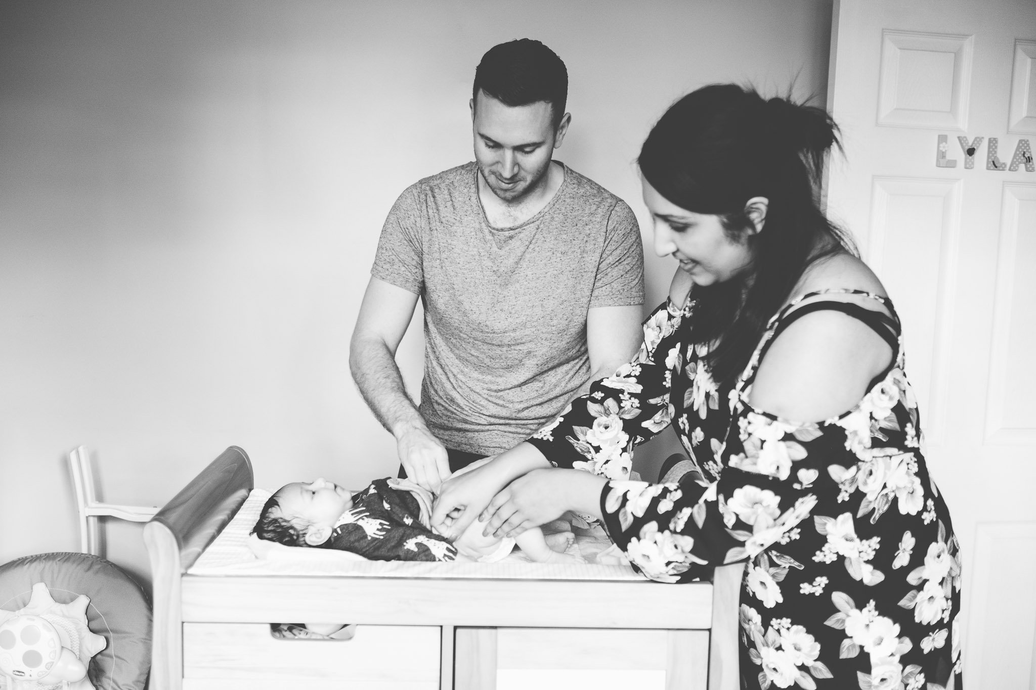 Mum & Dad changing baby's nappy Lifestyle photography Chiswick
