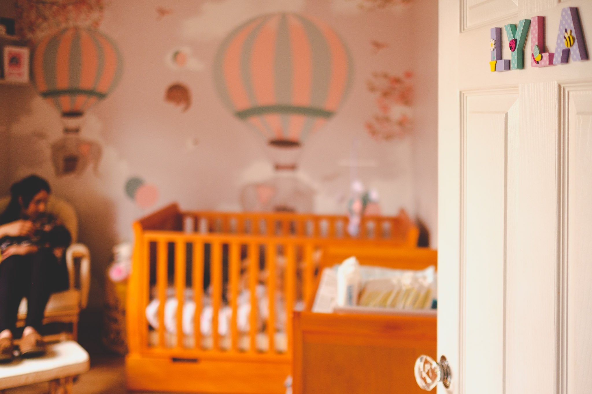 Open door to baby's nursery Lifestyle photography Chiswick