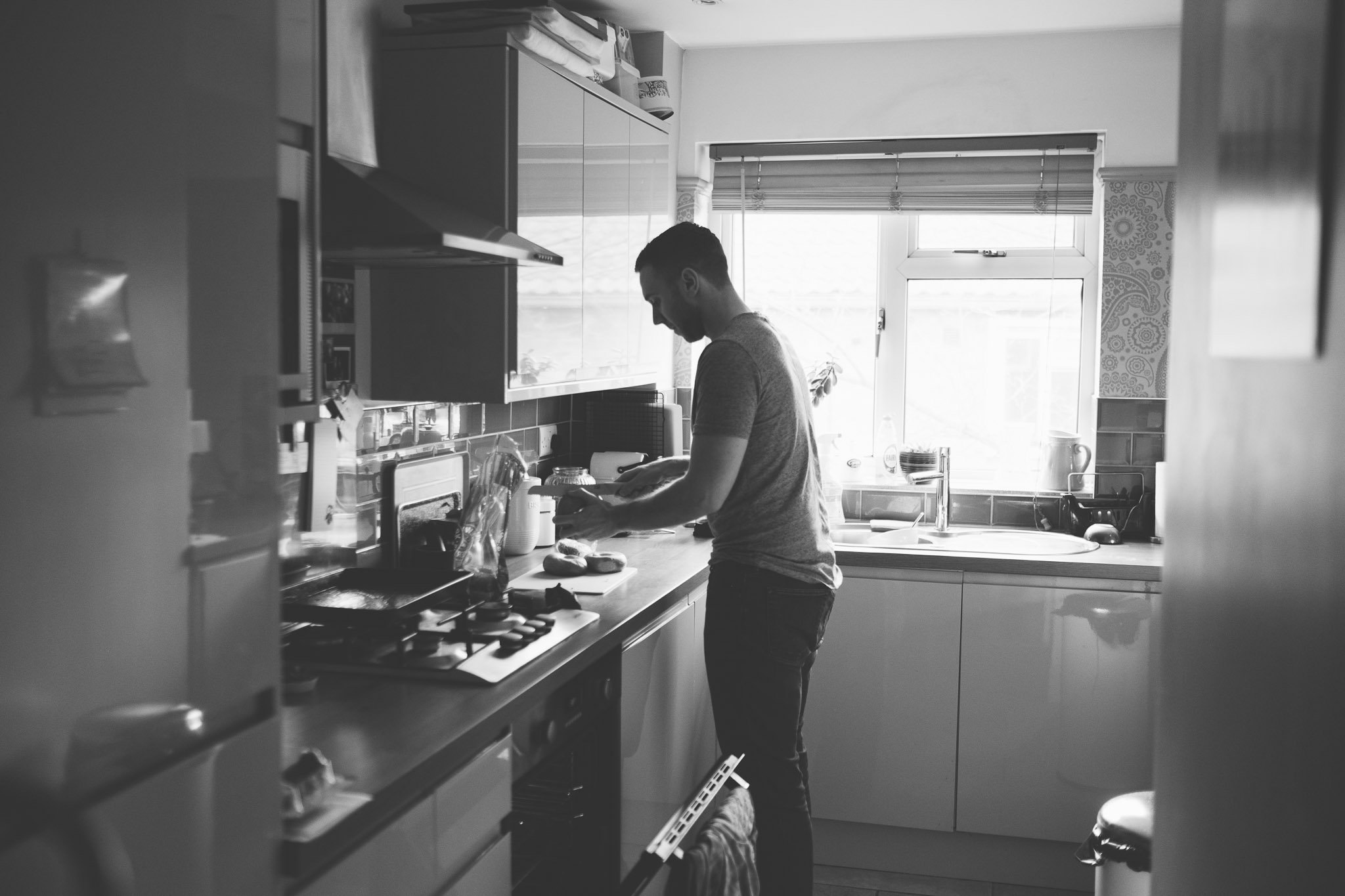 Dad in kitchen making lunch Lifestyle photography Chiswick