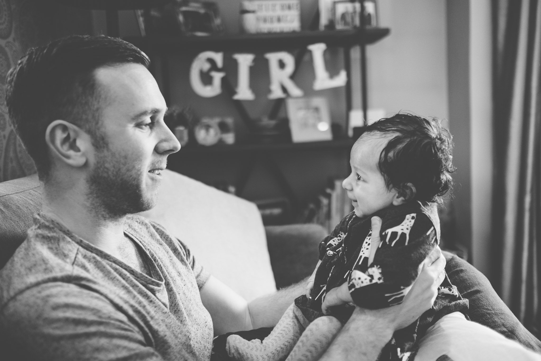 Dad holding happy baby Lifestyle photography Chiswick