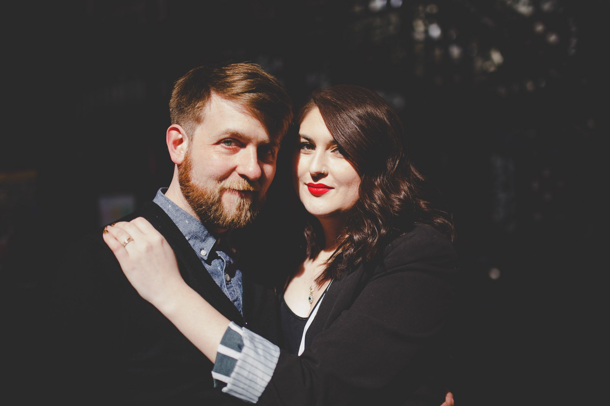 A couple pose for an engagement portrait in Smithfield's Market London. Photography by thatthingyoupluck.