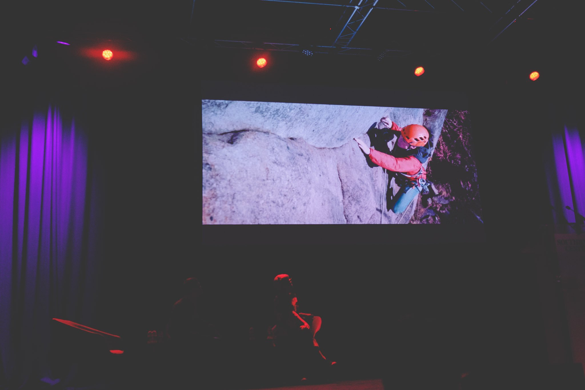 A video performance on a large screen by Poet Helen Mort on stage at the Southbank Centre London