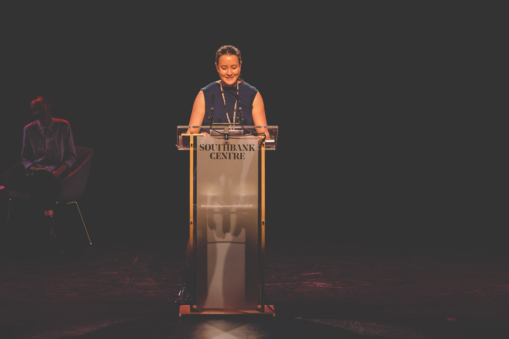 Close up of Poet Sarah Howe on stage reading her poetry at the Southbank Centre London.