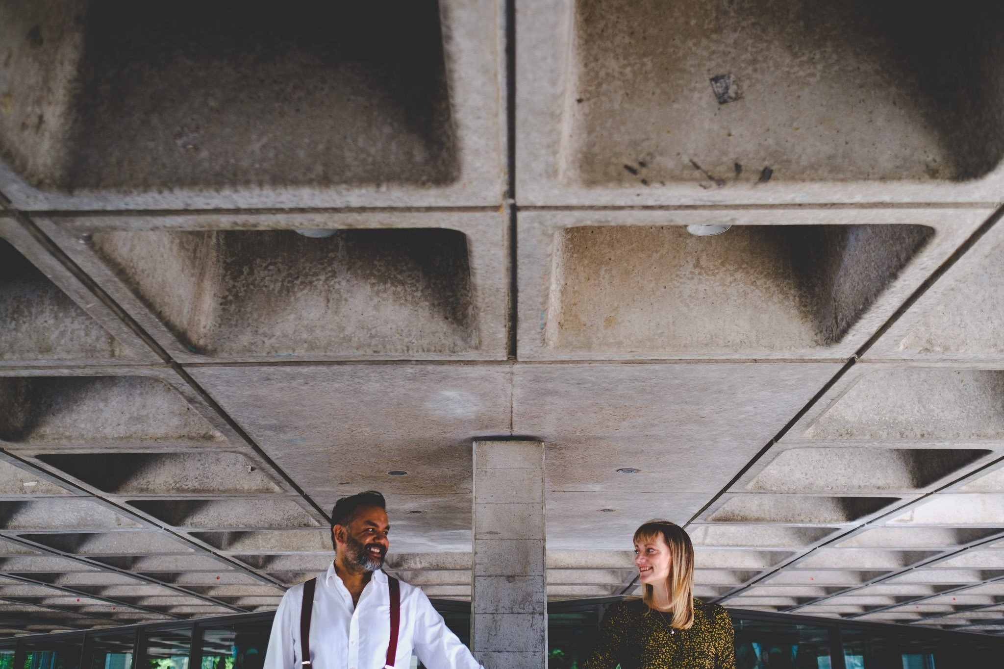 Couple holding hands in front of the Southbank Centre London engagement shoot. Photography by thatthingyoupluck.