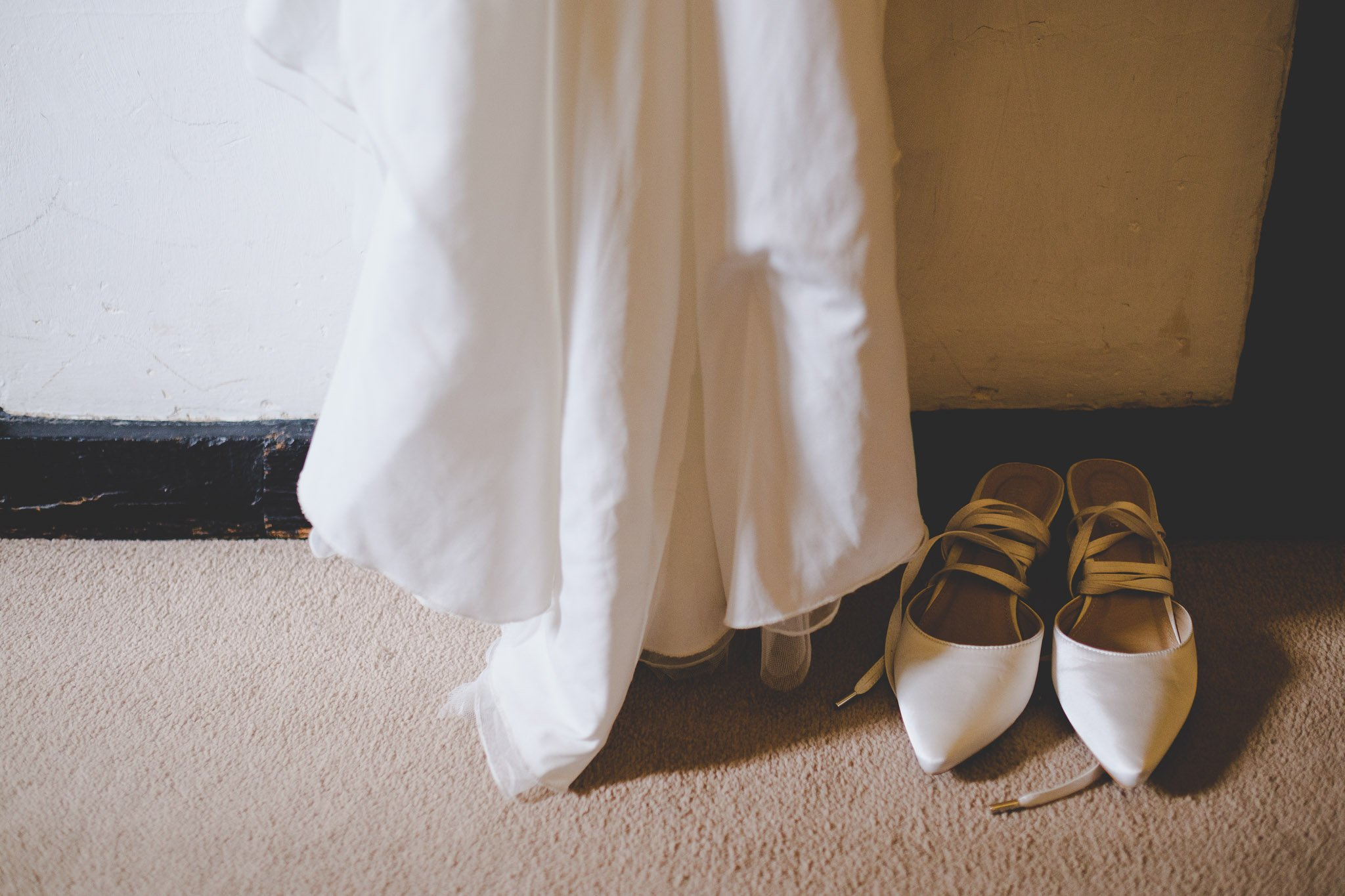Bottom of wedding dress and shoes