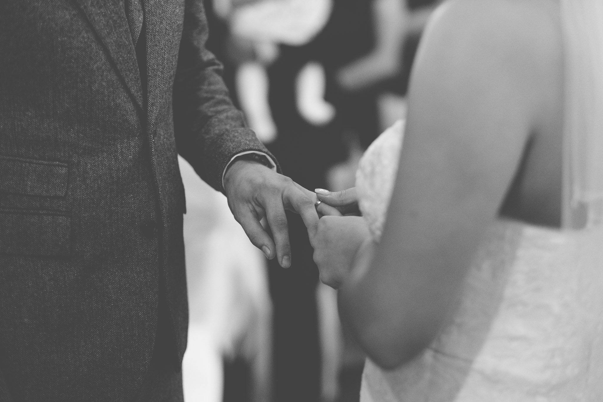 Close up of exchanging of rings at Leez Priory wedding