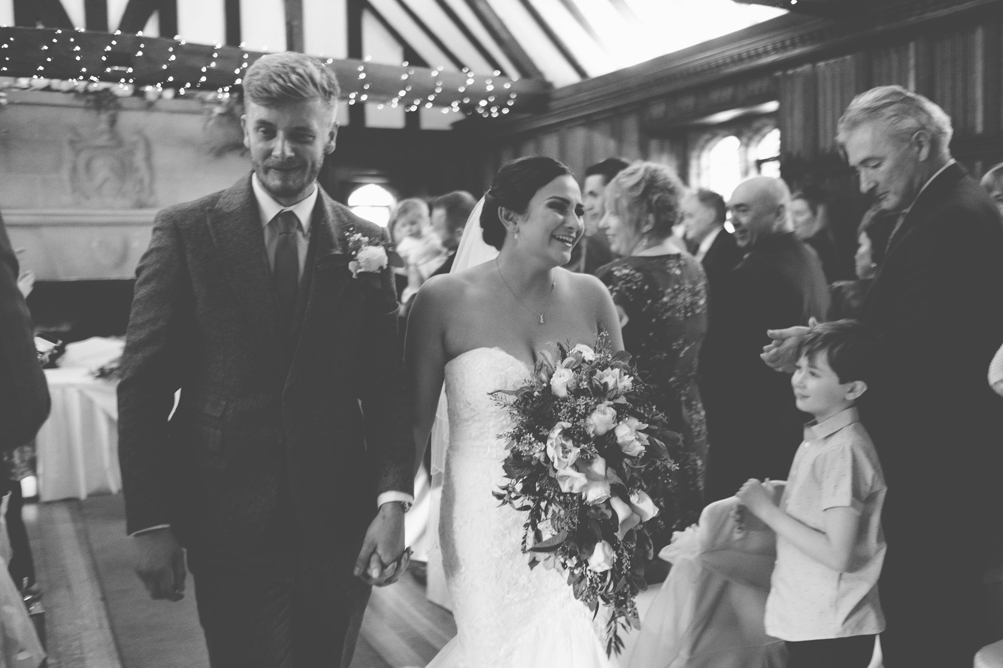 Just married bride and groom leave after ceremony at Leez Priory wedding