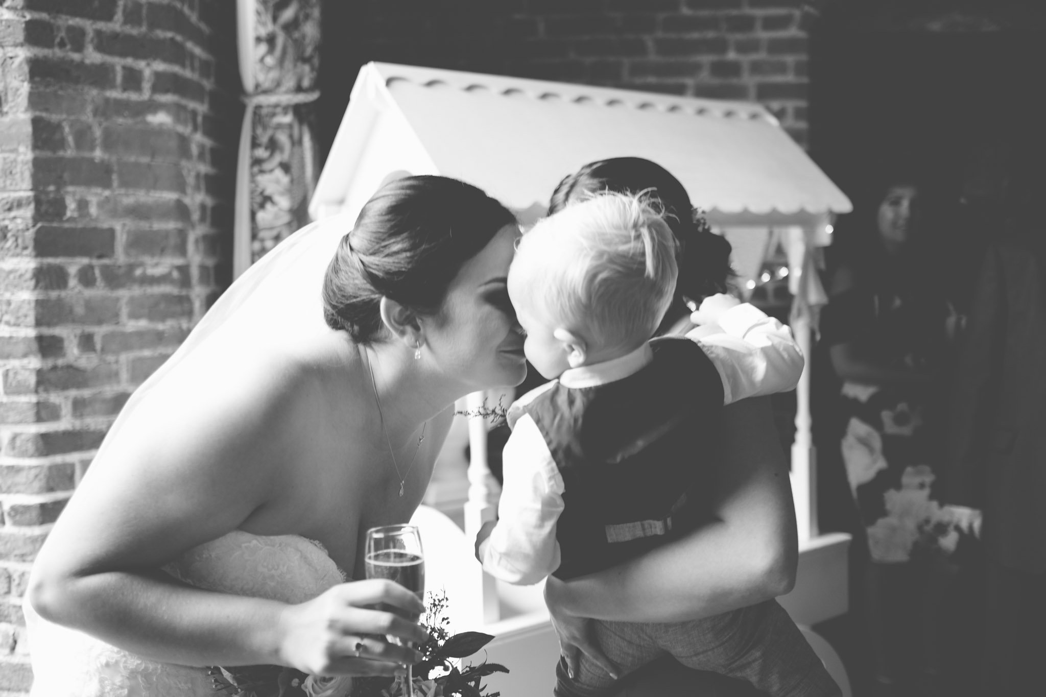 Bride kisses young son