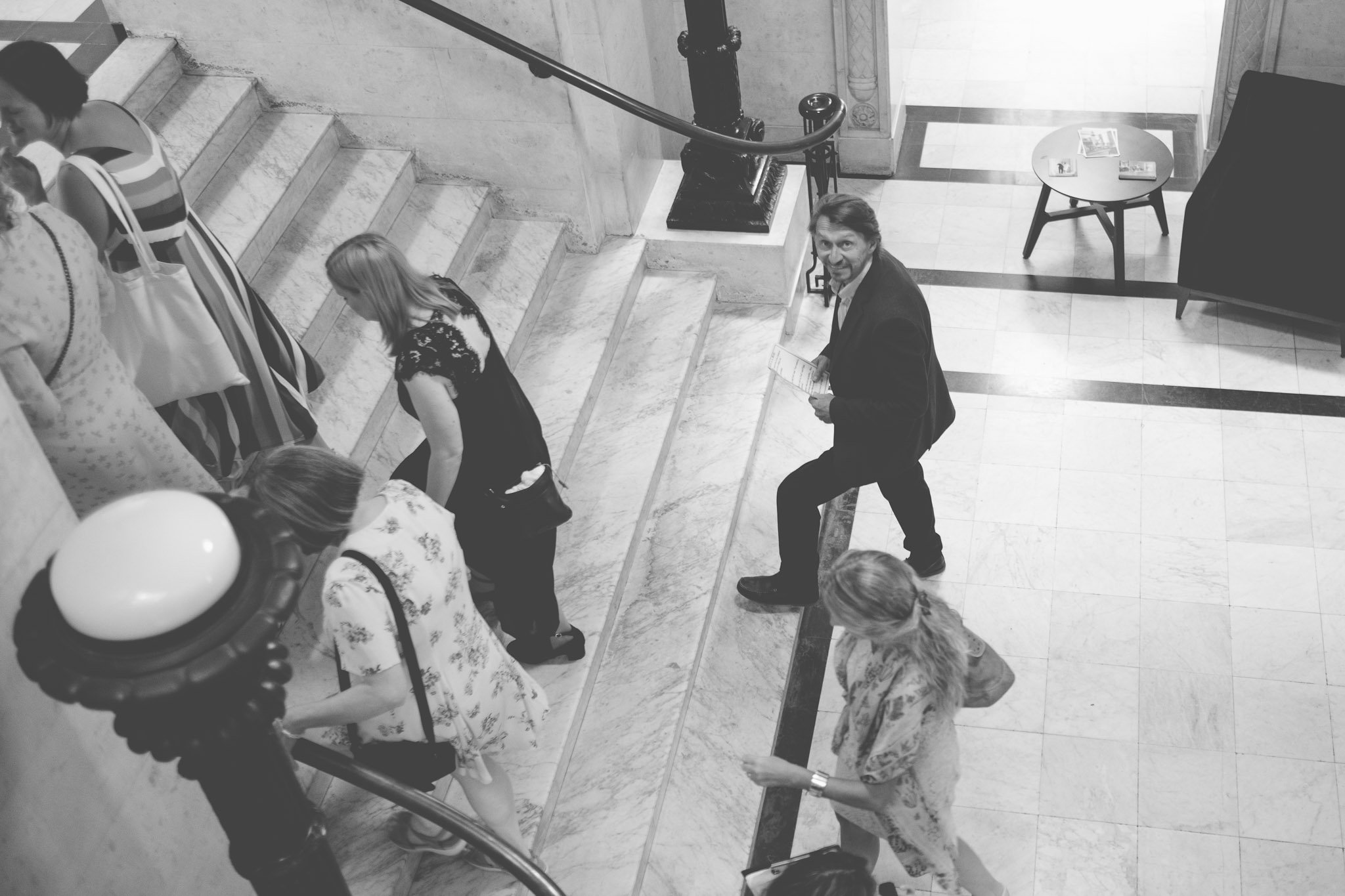 Wedding guests walking up the stairs of the Old Marylebone Town Hall London