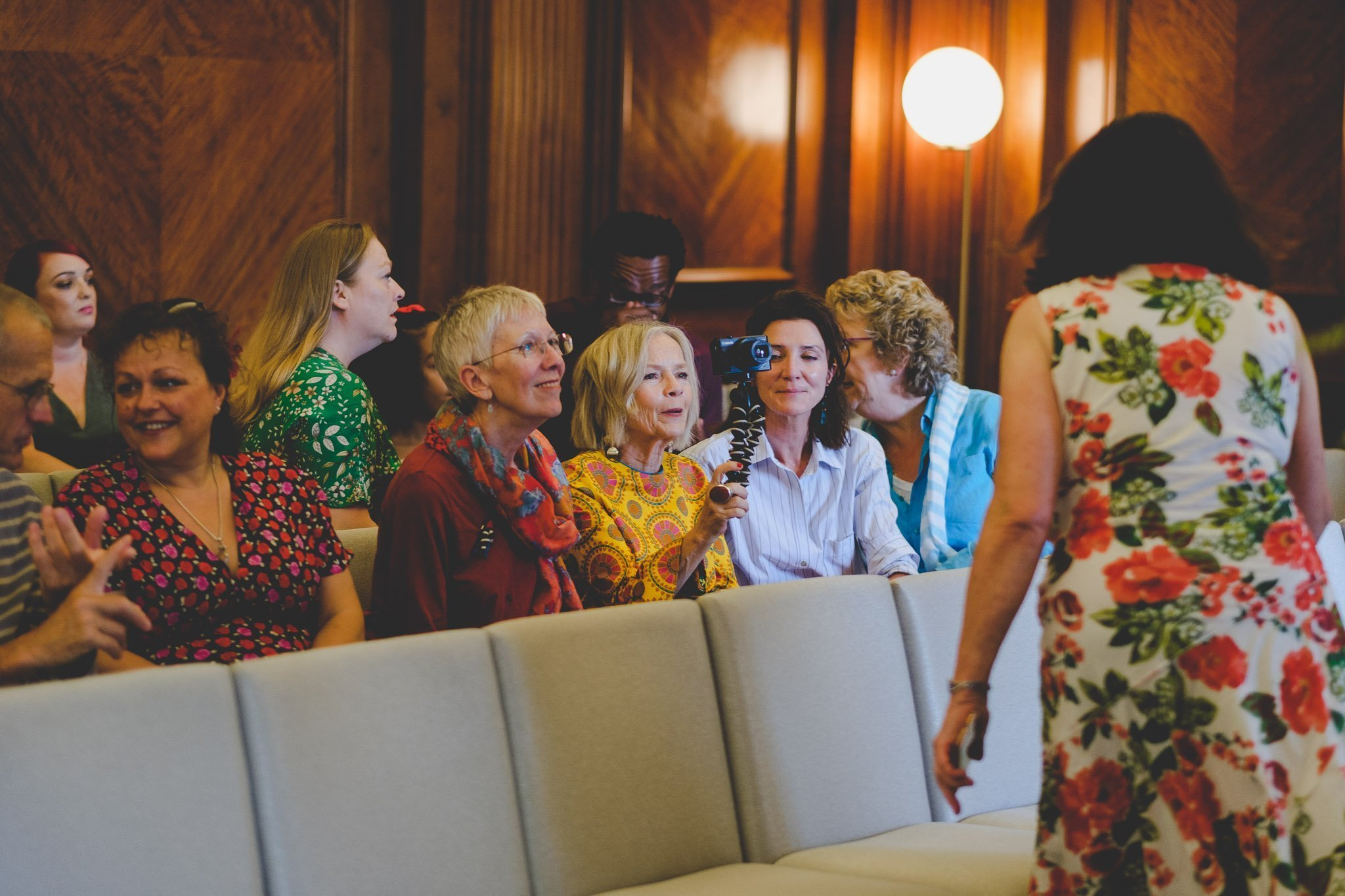 Wedding guests waiting in the Westminster Room of the Old Marylebone Town Hall London