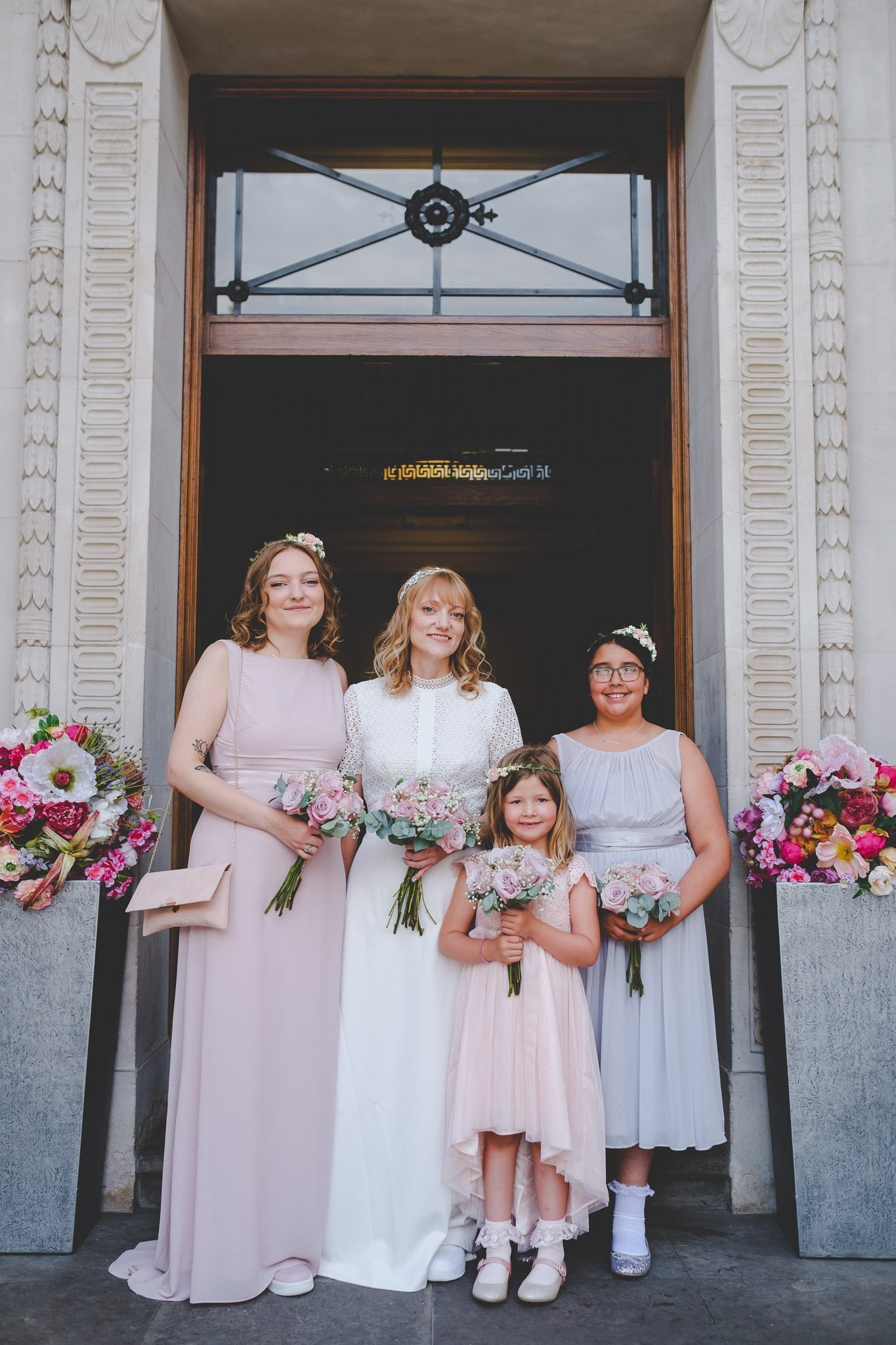 Portrait of bride and bridesmaids outside the Old Marylebone Town Hall London. Photography by thatthingyoupluck.