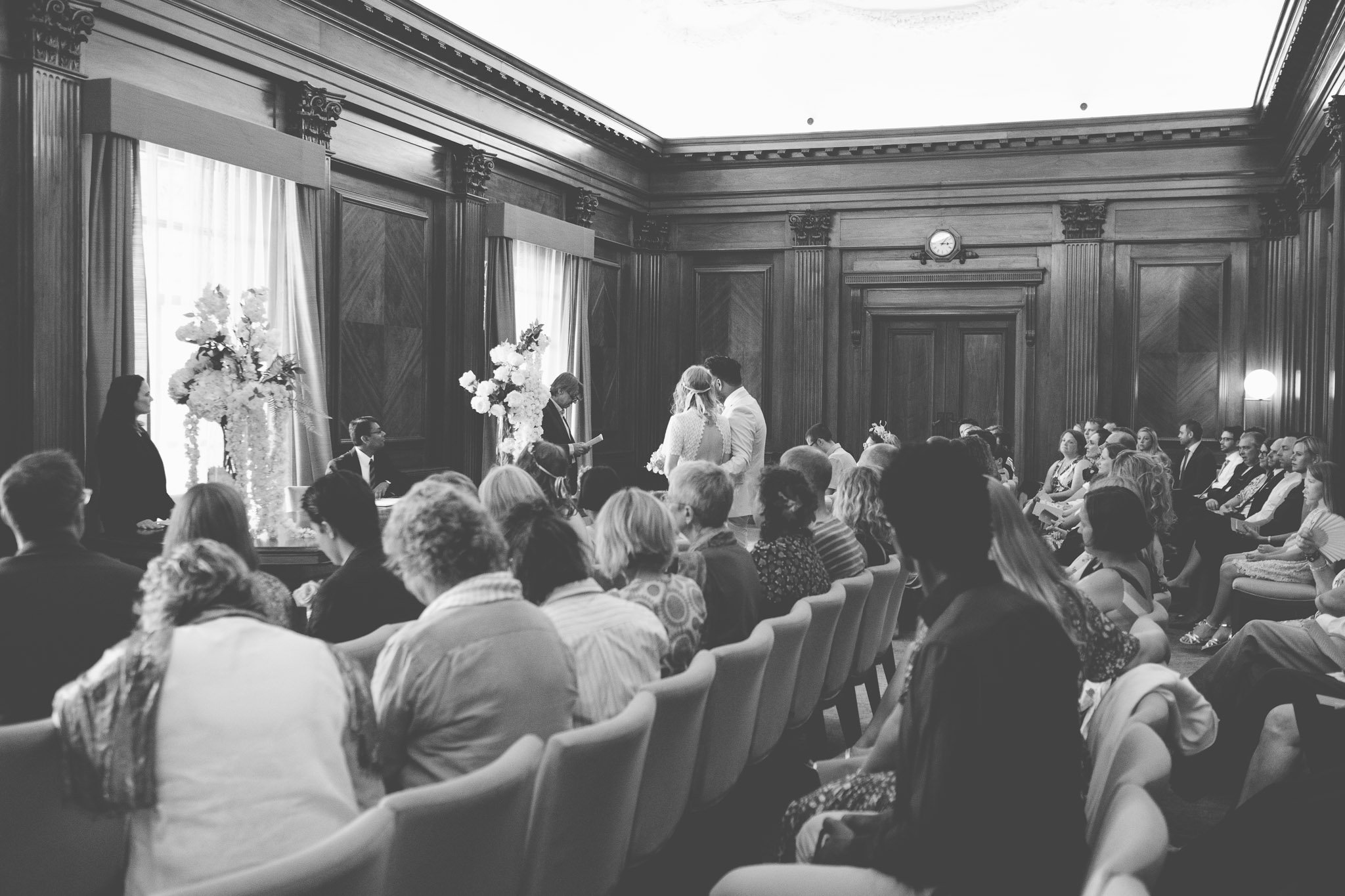 A reading by a wedding guest in the Westminster Room of the Old Marylebone Town Hall London.