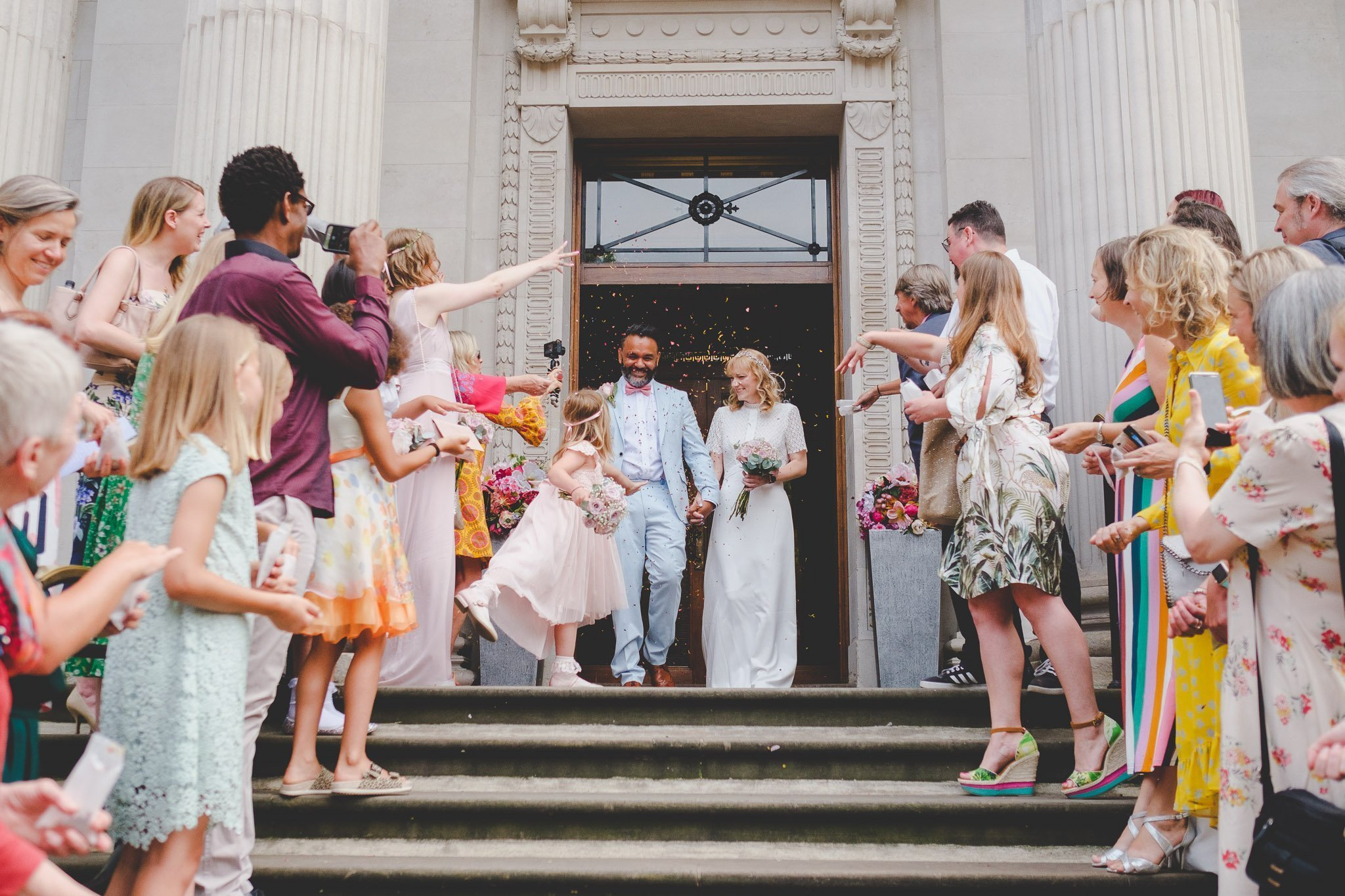 Confetti being thrown at a wedding on the steps of the Old Marylebone Town Hall London. Photography by thatthingyoupluck.